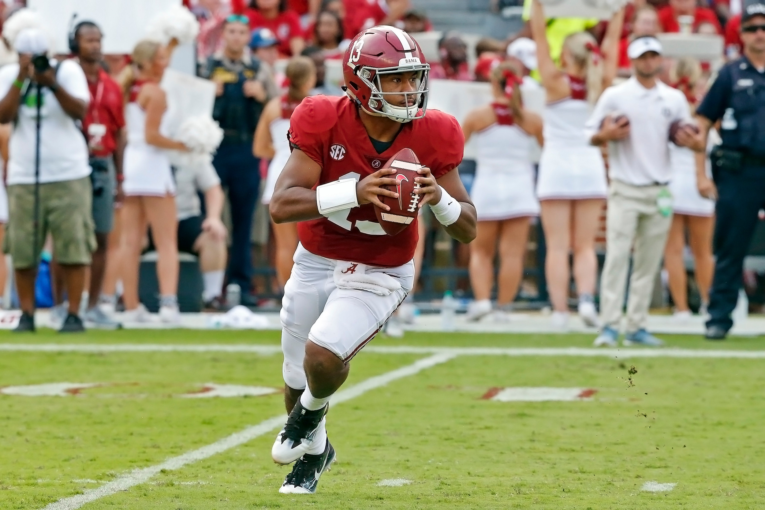Alabama Crimson Tide quarterback Tua Tagovailoa (13) looks for a receiver during the game with against the Texas A&M Aggies at Bryant-Denny Stadium.  Jason Clark / Daily Mountain Eagle