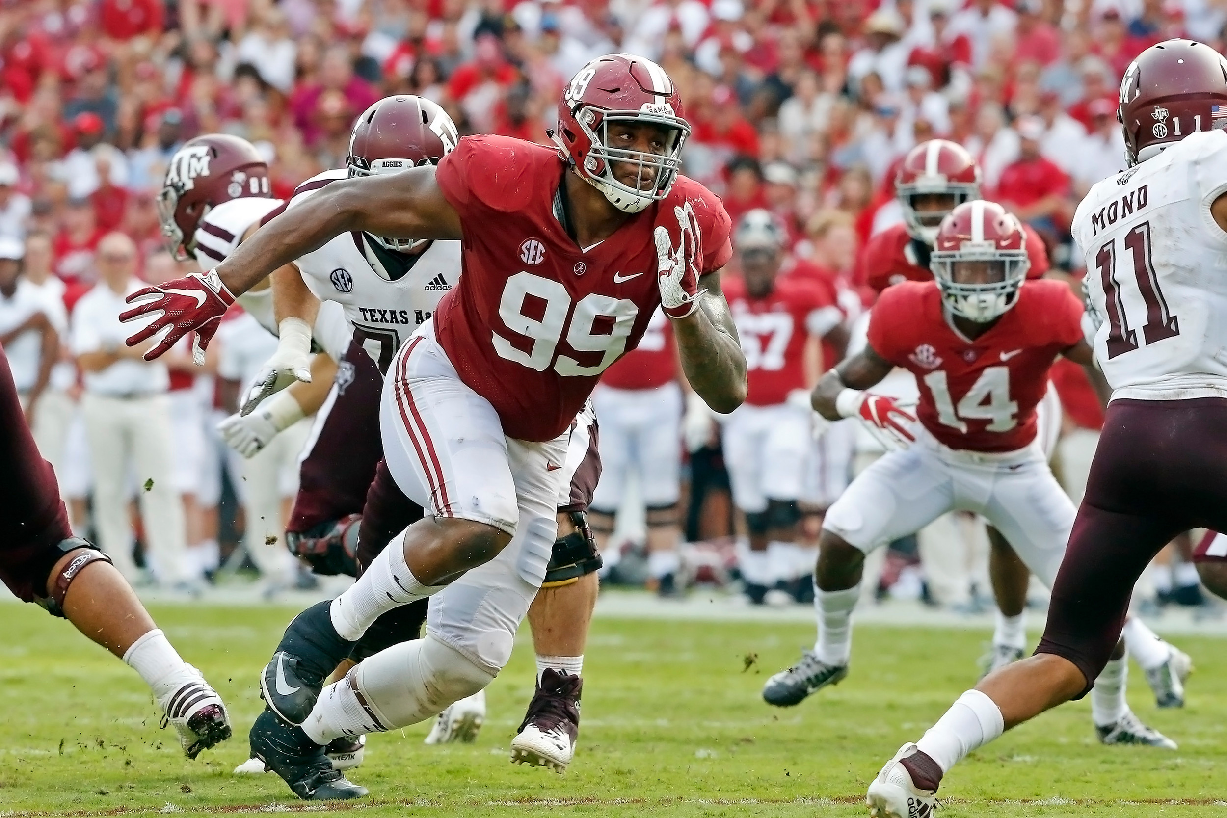 Alabama Crimson Tide defensive lineman Raekwon Davis (99) pressures the quarterback during the game with against the Texas A&M Aggies at Bryant-Denny Stadium.  Jason Clark / Daily Mountain Eagle