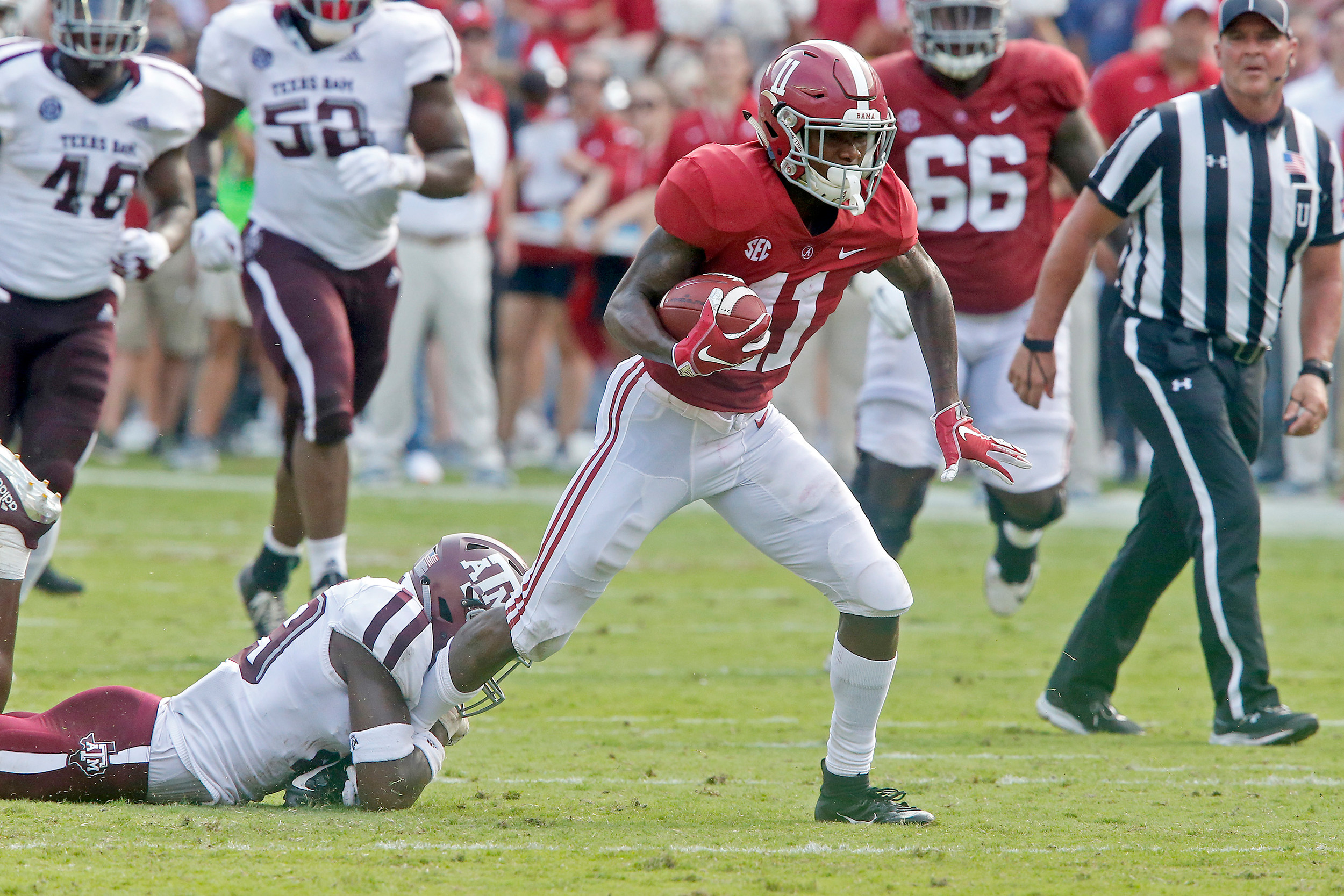 Alabama Crimson Tide wide receiver Henry Ruggs III (11) makes a first down after a reception during the game between the Texas A&M Aggies and the University of Alabama Crimson Tide at Bryant-Denny Stadium.  Jason Clark / Daily Mountain Eagle
