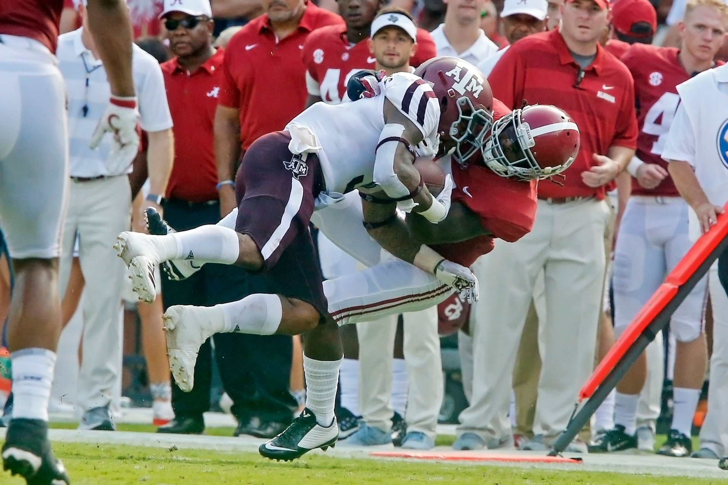 Alabama Crimson Tide defensive back Shyheim Carter (5) puts a hard hit on Texas A&M Aggies running back Trayveon Williams (5) during the game between the Texas A&M Aggies and the University of Alabama Crimson Tide at Bryant-Denny Stadium.  Jason Clark / Daily Mountain Eagle