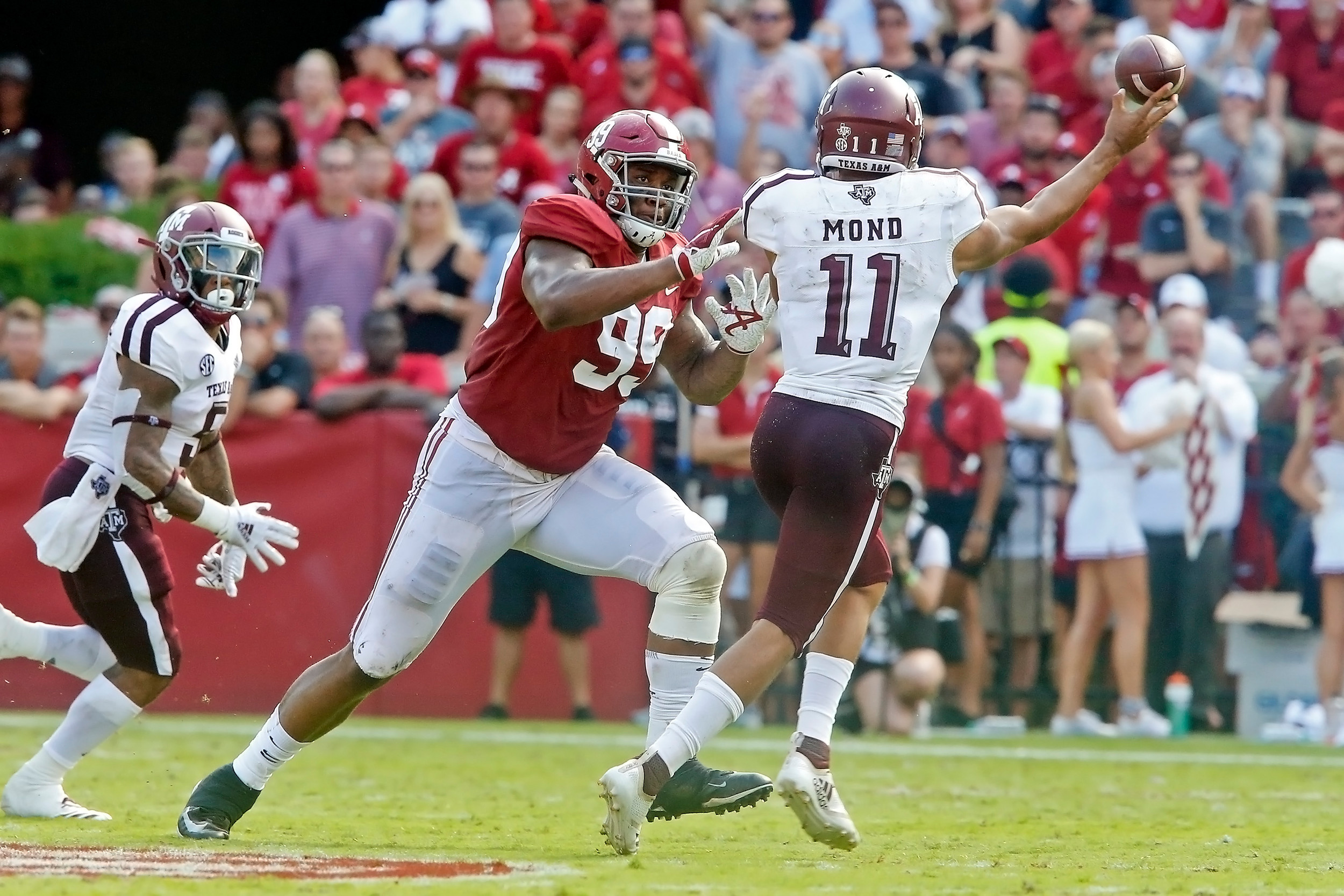 Alabama Crimson Tide defensive lineman Raekwon Davis (99) pressures Texas A&M Aggies quarterback Kellen Mond (11) during the game between the Texas A&M Aggies and the University of Alabama Crimson Tide at Bryant-Denny Stadium.  Jason Clark / Daily Mountain Eagle