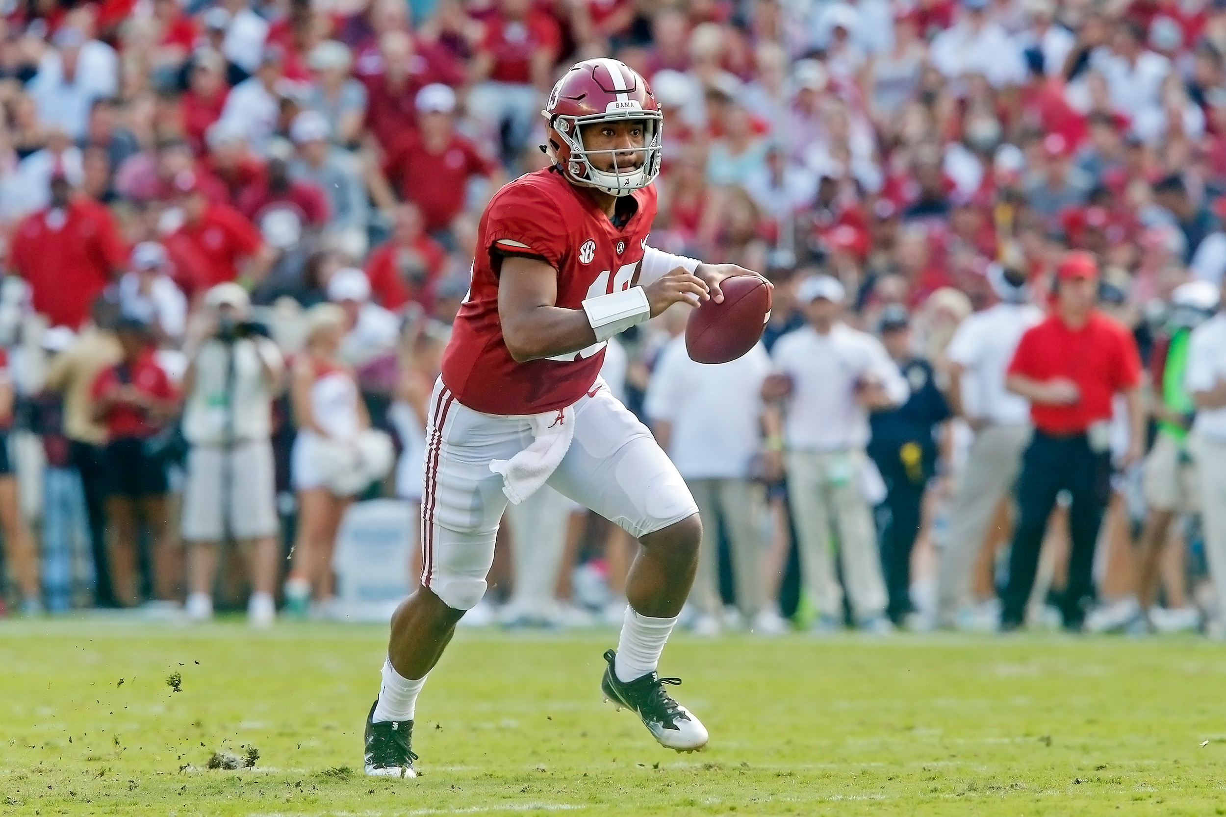 Alabama Crimson Tide quarterback Tua Tagovailoa (13) rushes during the game between the Texas A&M Aggies and the University of Alabama Crimson Tide at Bryant-Denny Stadium.  Jason Clark / Daily Mountain Eagle