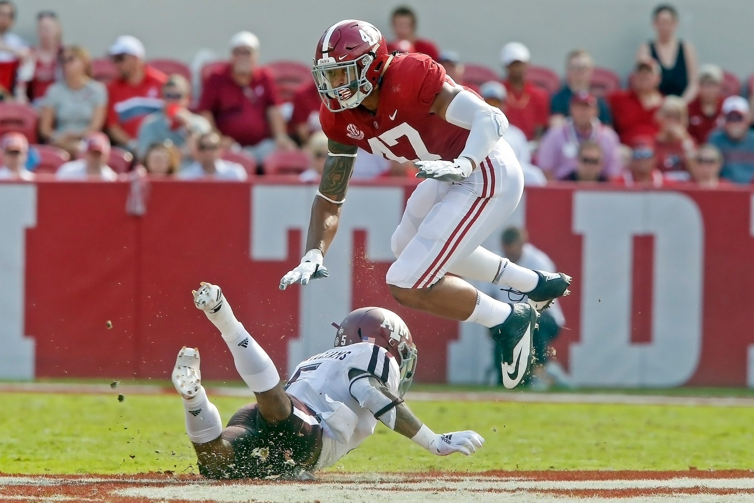 Texas A&M Aggies running back Trayveon Williams (5) attempts to block Alabama Crimson Tide linebacker Christian Miller (47) during the game between the Texas A&M Aggies and the University of Alabama Crimson Tide at Bryant-Denny Stadium.  Jason Clark / Daily Mountain Eagle