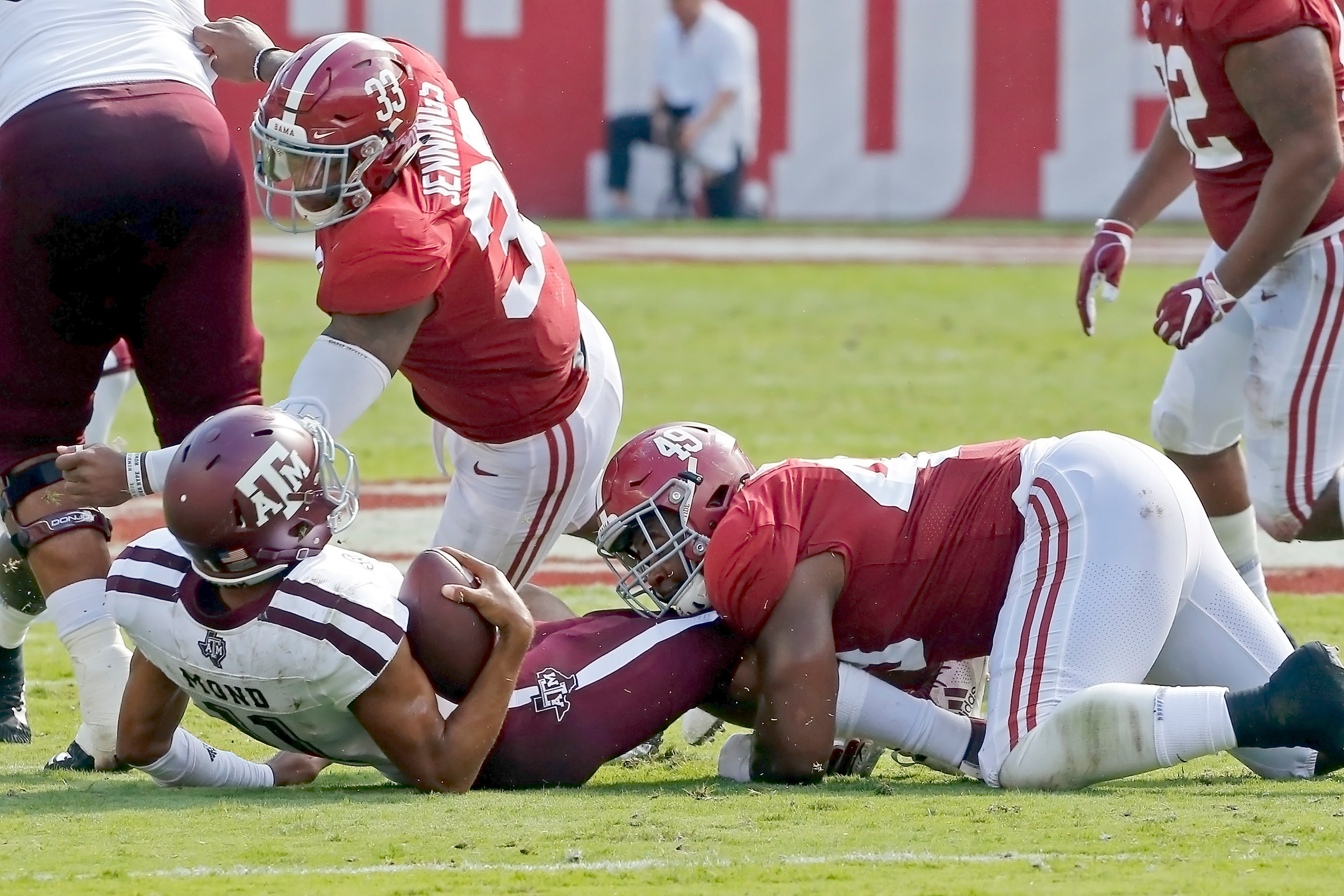 Alabama Crimson Tide defensive lineman Isaiah Buggs (49) put pressure on Texas A&M Aggies quarterback Kellen Mond (11) all day during the game between the Texas A&M Aggies and the University of Alabama Crimson Tide at Bryant-Denny Stadium.  Jason Clark / Daily Mountain Eagle
