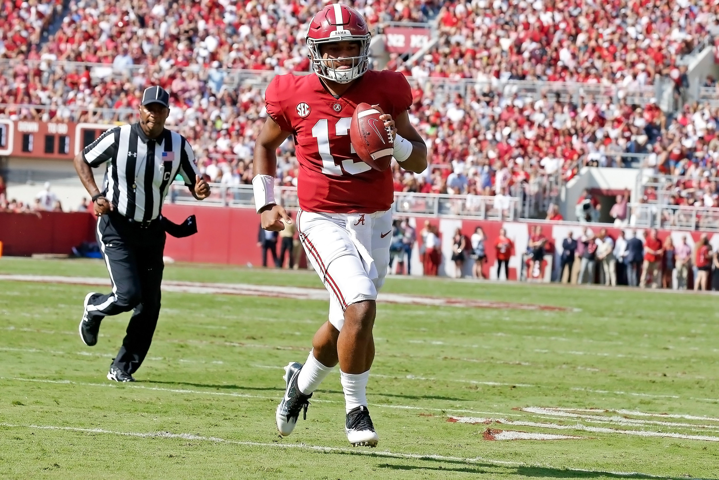 Alabama Crimson Tide quarterback Tua Tagovailoa (13) rushes for a touchdown during the game between the Texas A&M Aggies and the University of Alabama Crimson Tide at Bryant-Denny Stadium.  Jason Clark / Daily Mountain Eagle