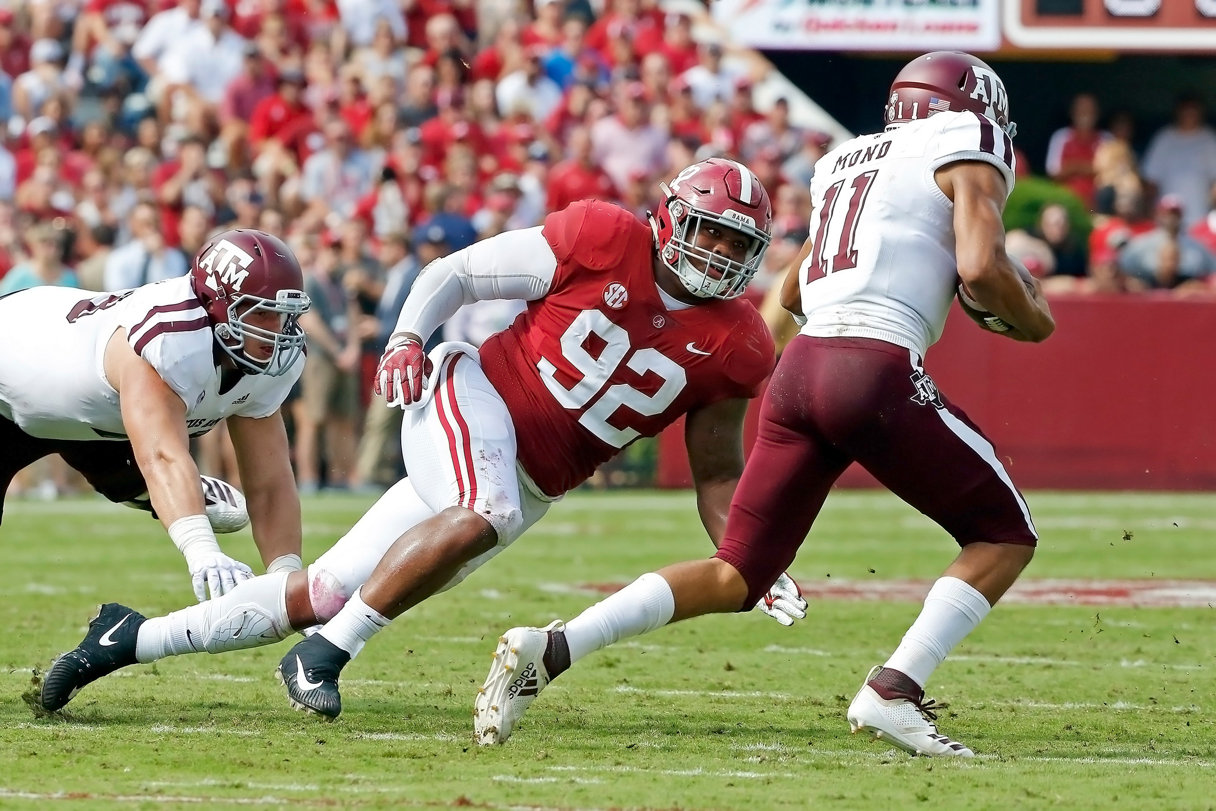 Alabama Crimson Tide defensive lineman Quinnen Williams (92) puts pressure on Texas A&M Aggies quarterback Kellen Mond (11) during the game between the Texas A&M Aggies and the University of Alabama Crimson Tide at Bryant-Denny Stadium.  Jason Clark / Daily Mountain Eagle