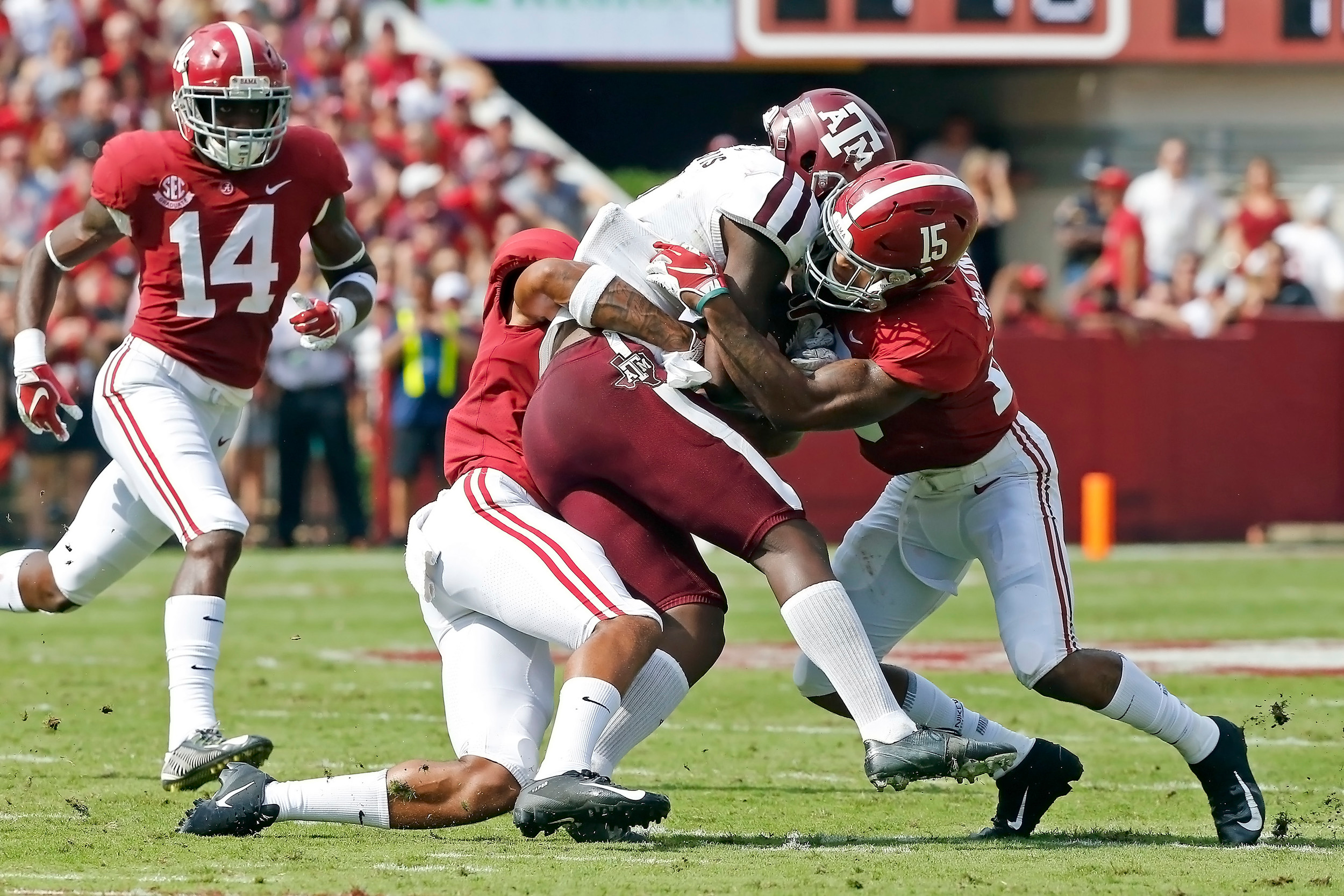 Alabama Crimson Tide defensive backs Patrick Surtain II (2) and Xavier McKinney (15) combine on a tackle during the game between the Texas A&M Aggies and the University of Alabama Crimson Tide at Bryant-Denny Stadium.  Jason Clark / Daily Mountain Eagle