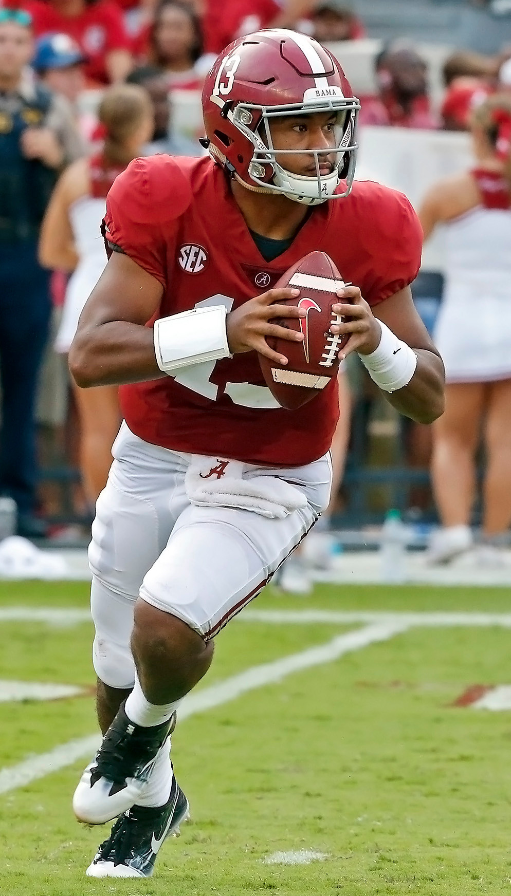 Alabama quarterback Tua Tagovailoa (13) threw for 387 yards and five touchdowns in the Tide's win over Texas A&M on Saturday.