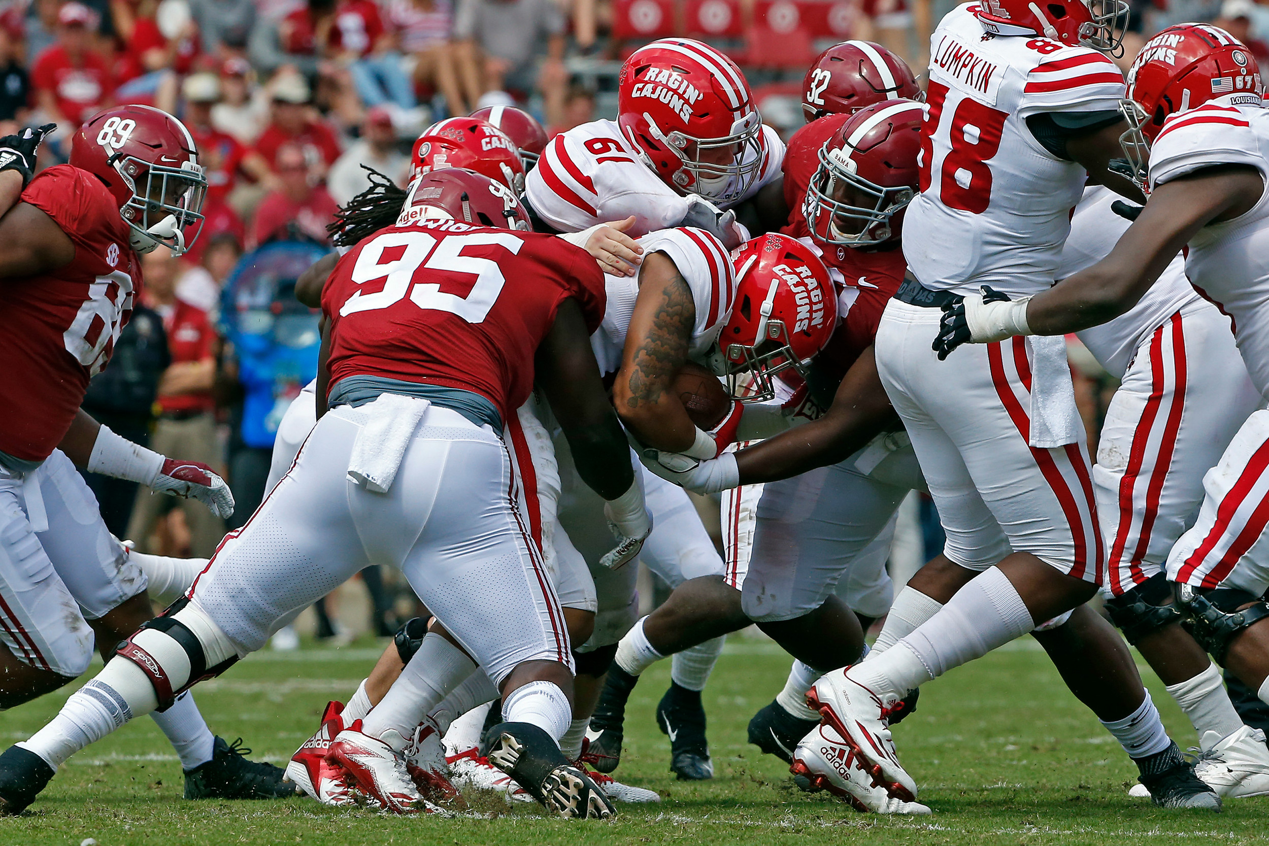 Alabama Crimson Tide defensive linemen Johnny Dwight (95) and  Phidarian Mathis (48) combine for a tackle at Bryant-Denny Stadium in Tuscaloosa, Al on September 29, 2018. Jason Clark / Daily Mountain Eagle