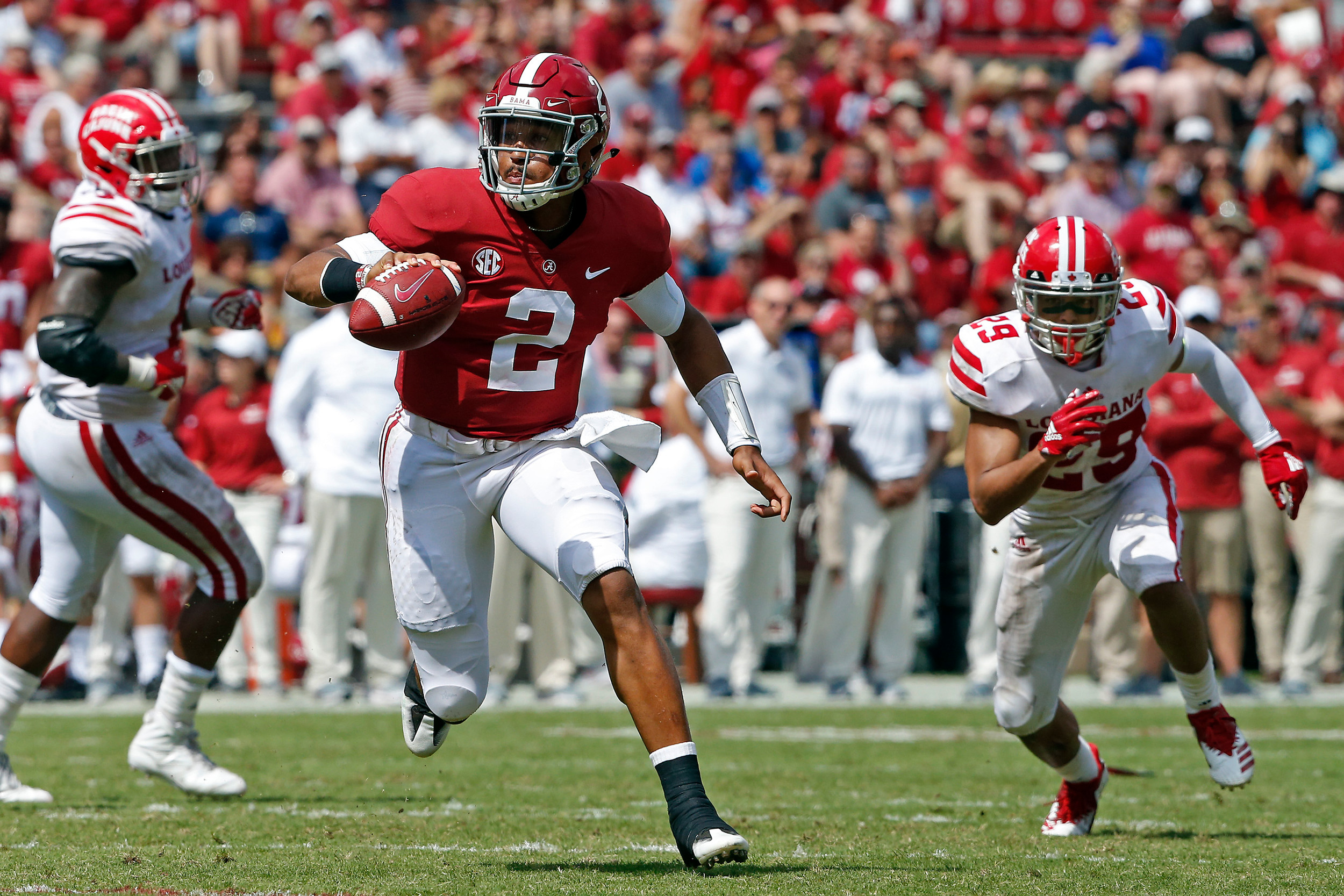 Alabama Crimson Tide quarterback Jalen Hurts (2) gains yardage for a first down at Bryant-Denny Stadium in Tuscaloosa, Al on September 29, 2018. Jason Clark / Daily Mountain Eagle