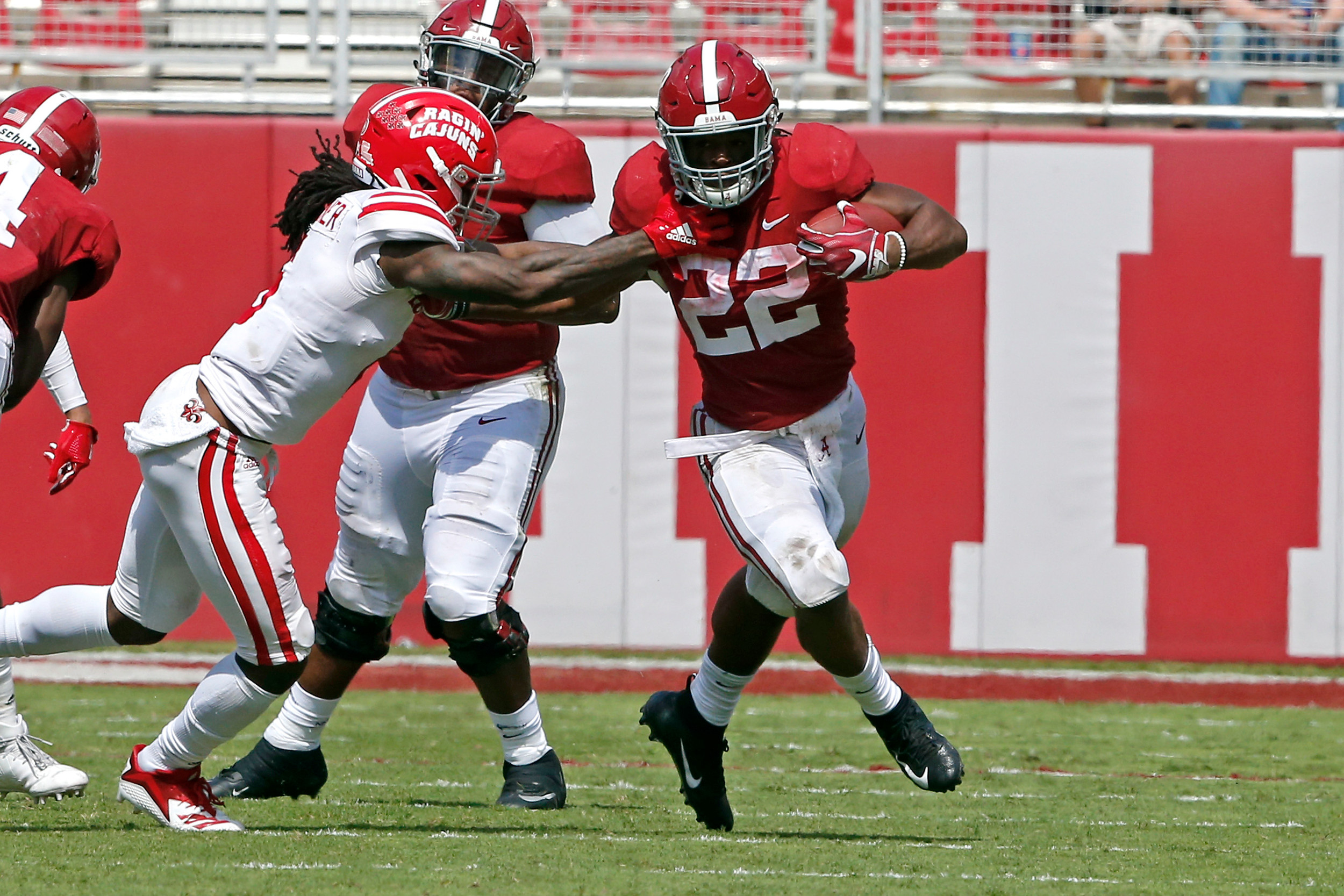 Alabama Crimson Tide running back Najee Harris (22) uses a stiff arm during a gain at Bryant-Denny Stadium in Tuscaloosa, Al on September 29, 2018. Jason Clark / Daily Mountain Eagle