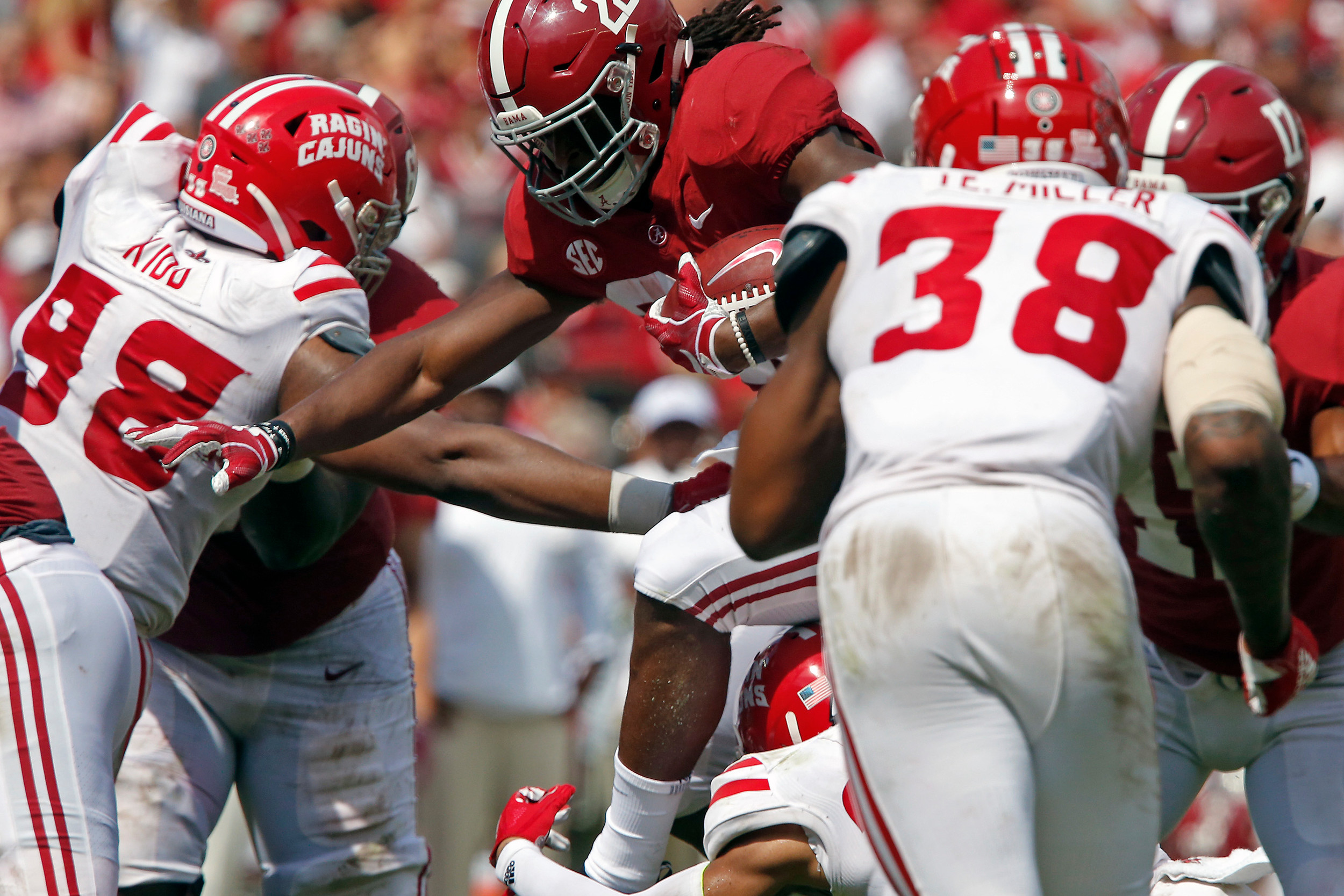 Alabama Crimson Tide running back Najee Harris (22) leaps a would be tackler at Bryant-Denny Stadium in Tuscaloosa, Al on September 29, 2018. Jason Clark / Daily Mountain Eagle