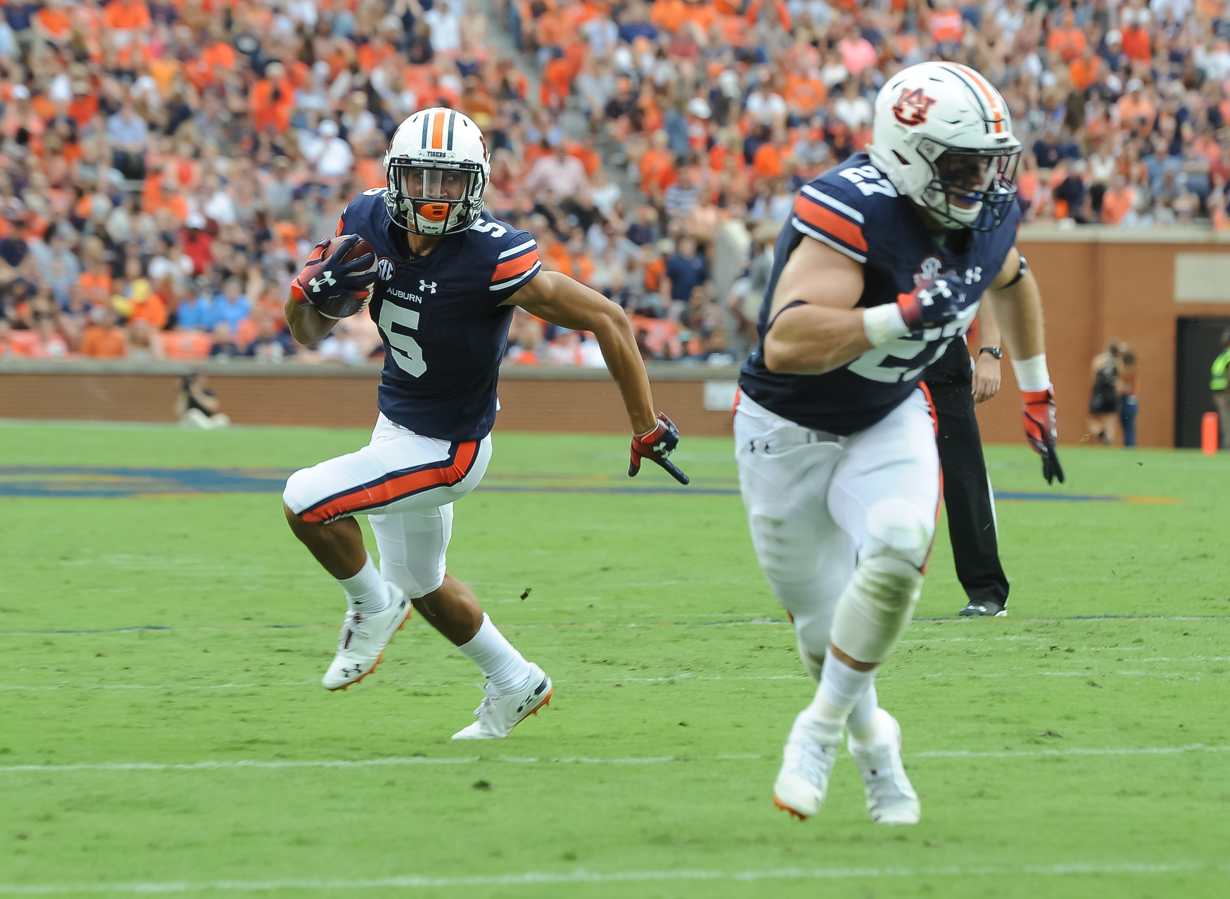 Auburn Tigers wide receiver Anthony Schwartz (5) runs behind the blocking of Auburn Tigers fullback Chandler Cox (27) during the first half of Saturday's game, at Jordan Hare Stadium in Auburn AL. Daily Mountain Eagle -  Jeff Johnsey