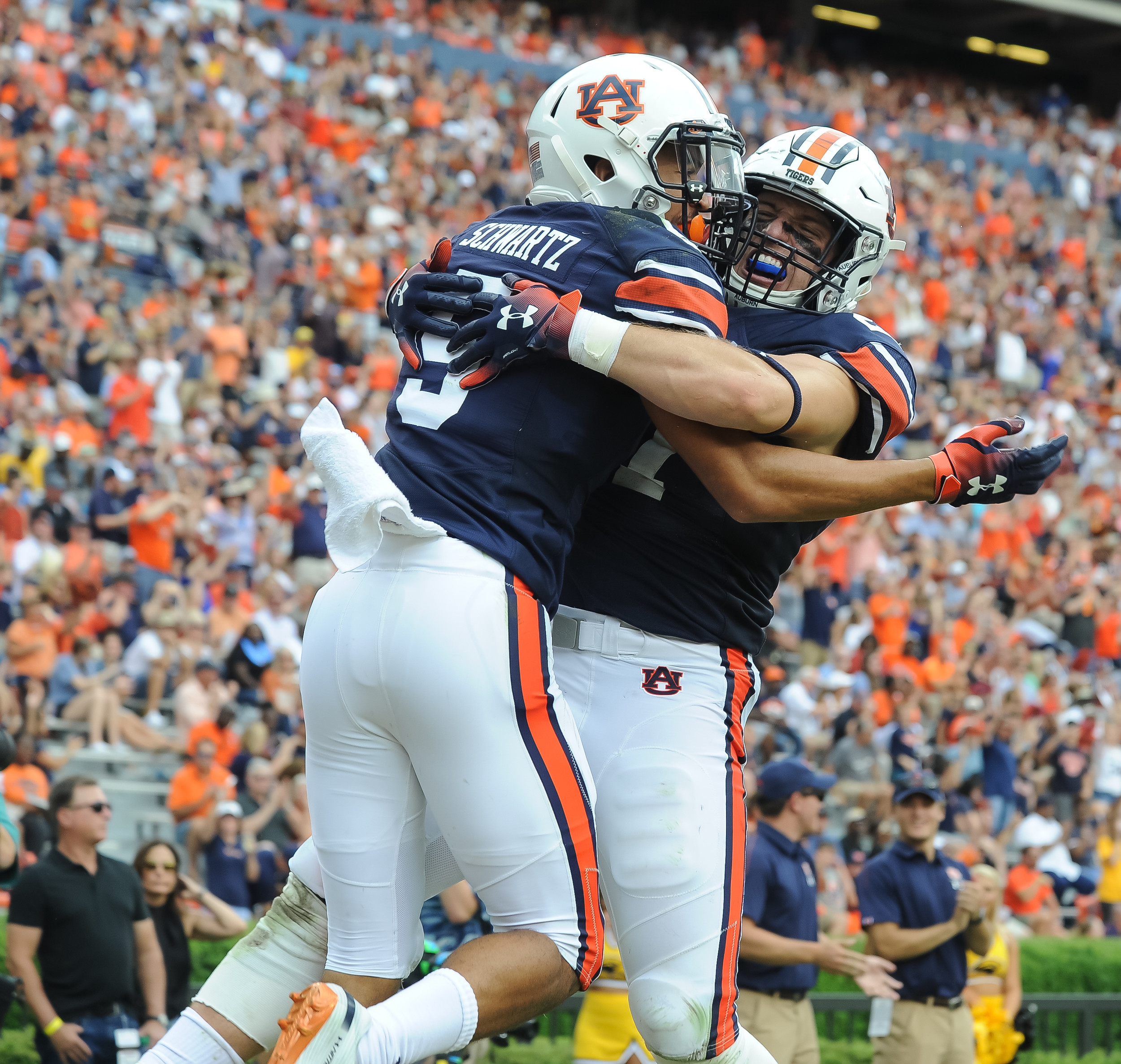 Auburn Tigers wide receiver Anthony Schwartz (5) and fullback Chandler Cox (27) celebrate after Schwartz' touchdown run during the first half of Saturday's game, at Jordan Hare Stadium in Auburn AL. Daily Mountain Eagle -  Jeff Johnsey