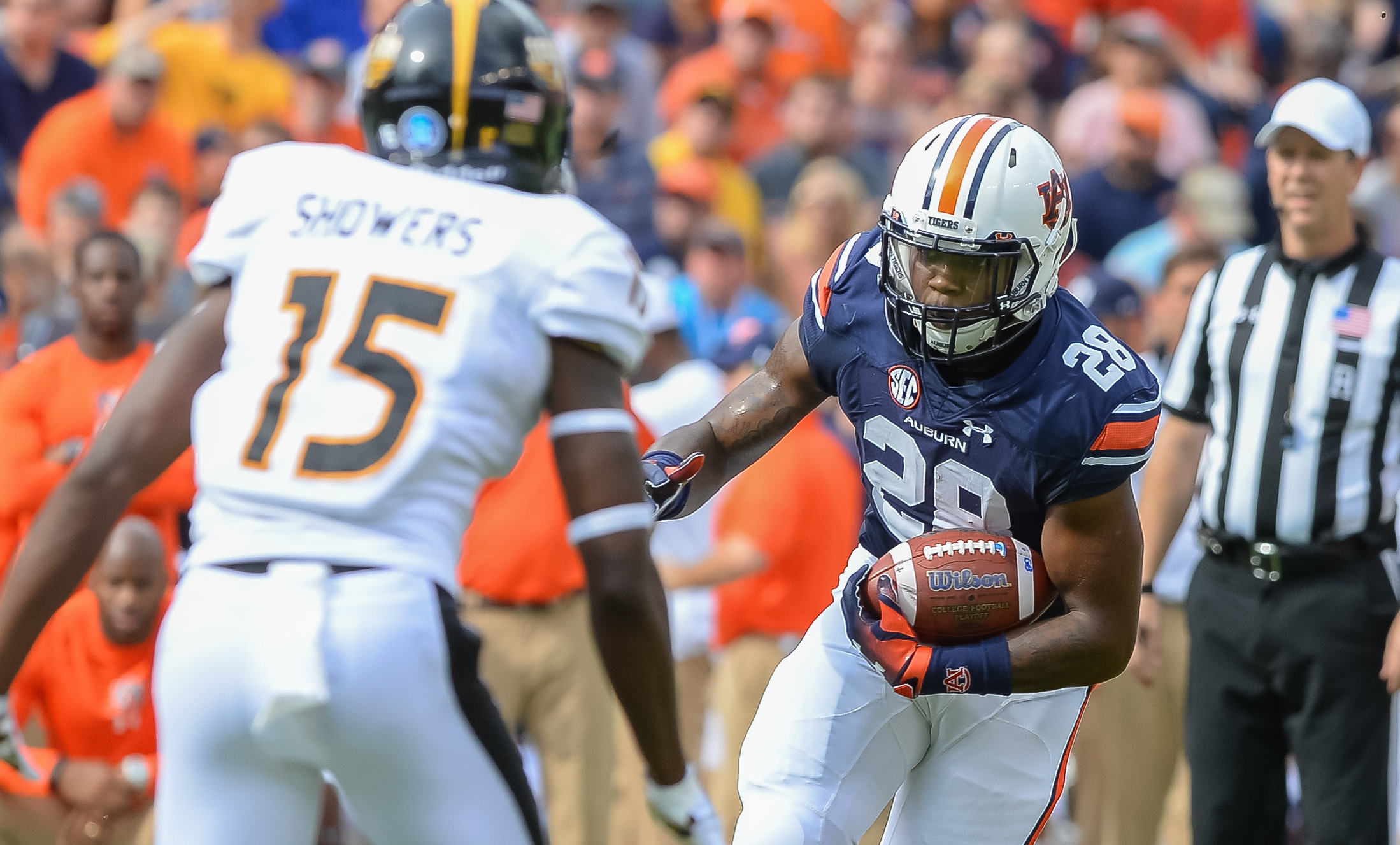 Auburn Tigers running back JaTarvious Whitlow (28) runs during the first half of Saturday's game, at Jordan Hare Stadium in Auburn AL. Daily Mountain Eagle -  Jeff Johnsey