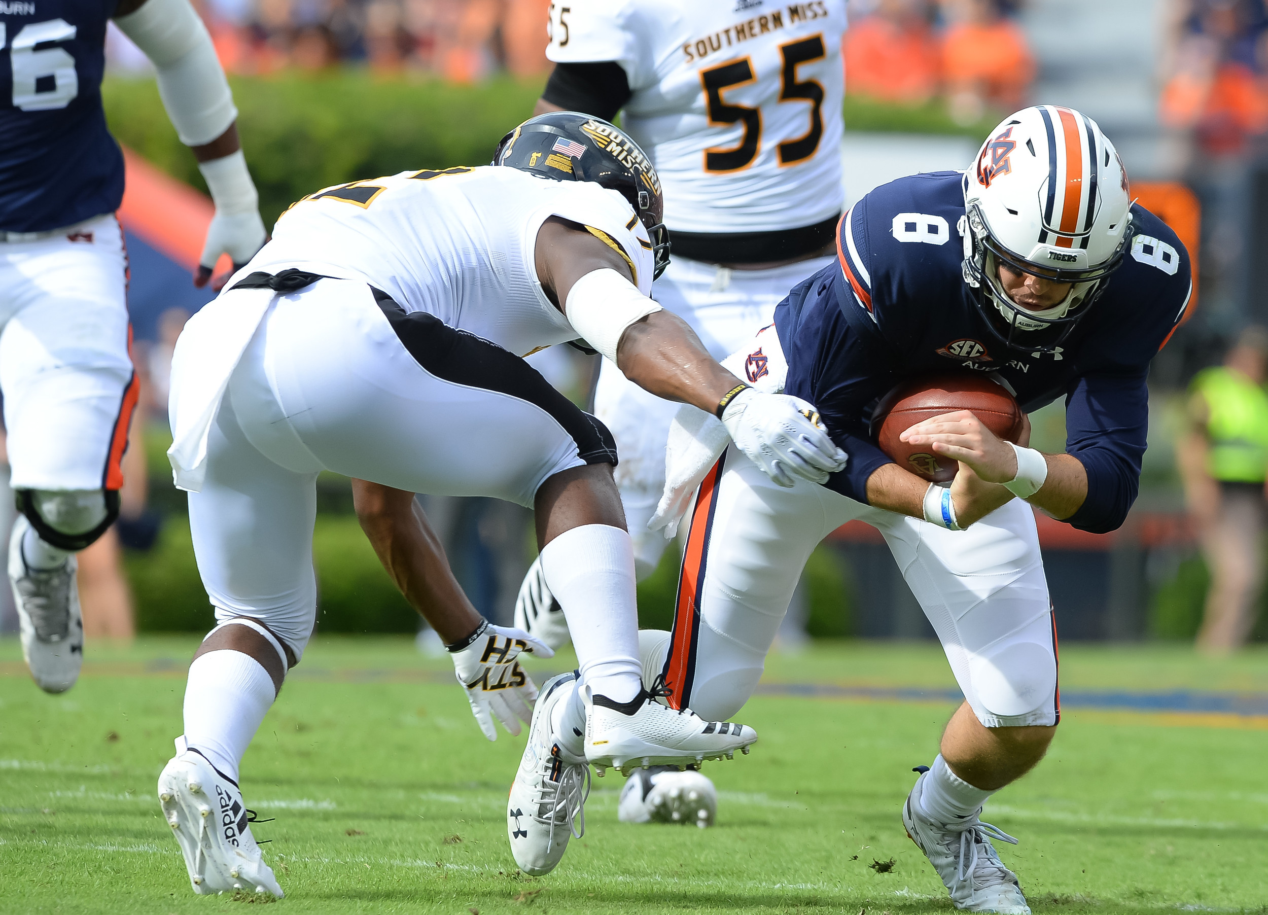 Auburn Tigers quarterback Jarrett Stidham (8) is tackled by Southern Miss Golden Eagles defensive back D.Q. Thomas (12) during the first half of Saturday's game, at Jordan Hare Stadium in Auburn AL. Daily Mountain Eagle -  Jeff Johnsey