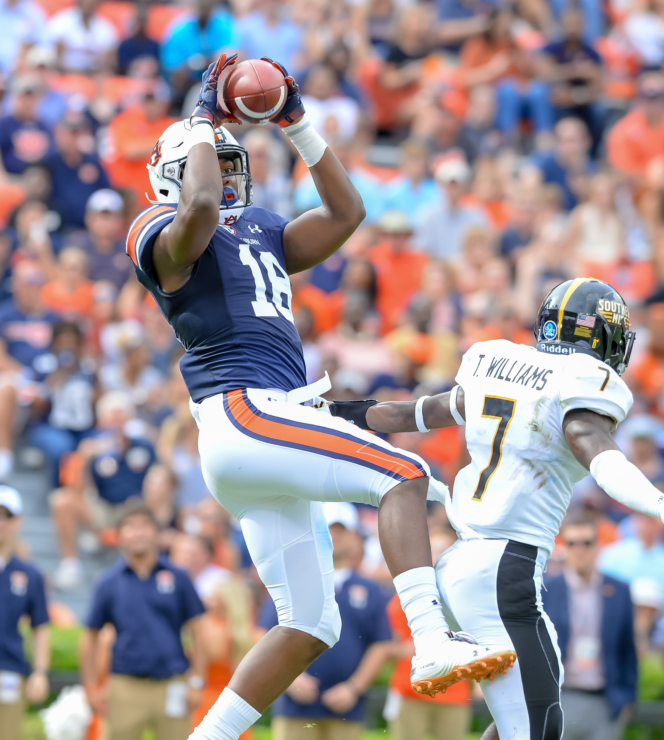 Auburn Tigers wide receiver Seth Williams (18) catches a touchdown pass over Southern Miss Golden Eagles defensive back Ty Williams (7) during the first half of Saturday's game, at Jordan Hare Stadium in Auburn AL. Daily Mountain Eagle -  Jeff Johnsey