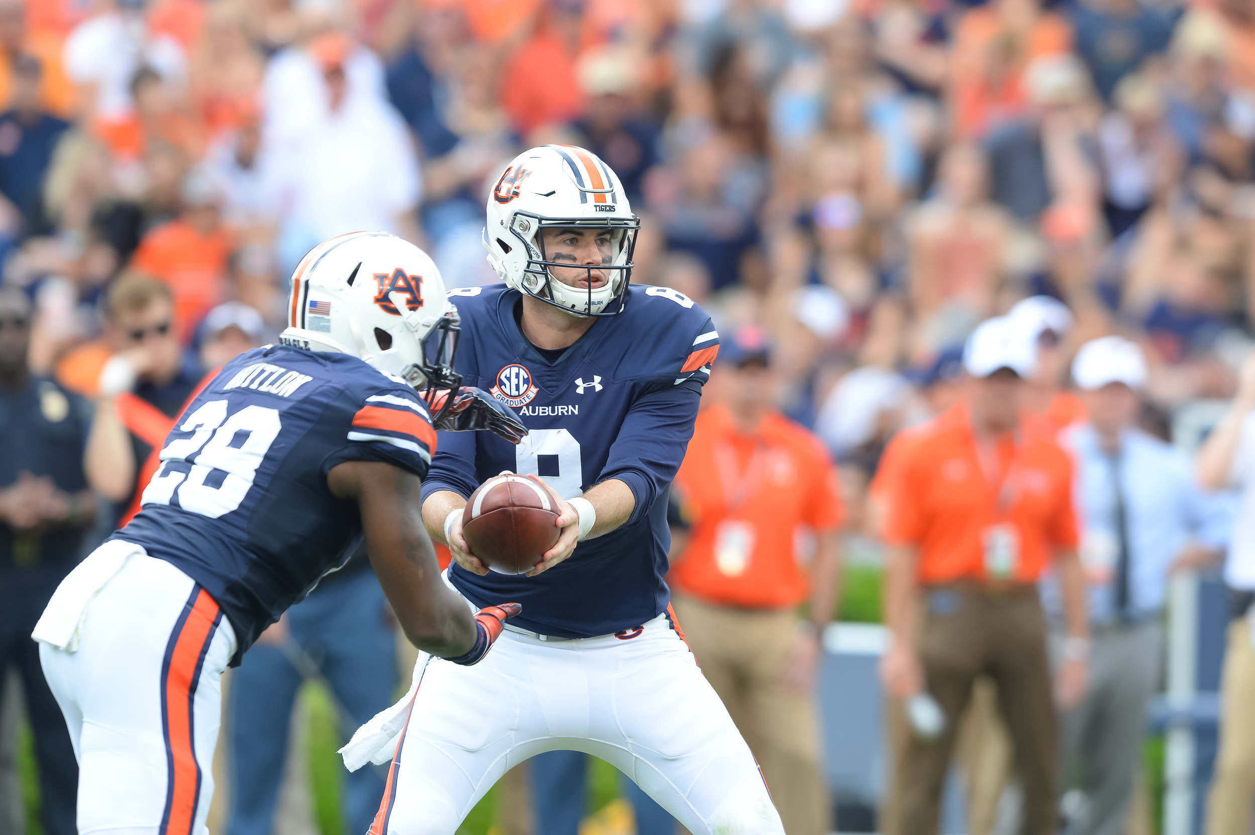 Auburn Tigers quarterback Jarrett Stidham (8) hands off to 1running back JaTarvious Whitlow (28) during the first half of Saturday's game, at Jordan Hare Stadium in Auburn AL. Daily Mountain Eagle -  Jeff Johnsey