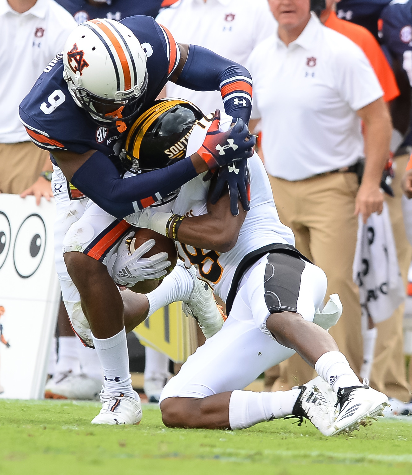 Auburn Tigers defensive back Jamien Sherwood (9) tackles Southern Miss Golden Eagles wide receiver De'Michael Harris (18) during the first half of Saturday's game, at Jordan Hare Stadium in Auburn AL. Daily Mountain Eagle -  Jeff Johnsey
