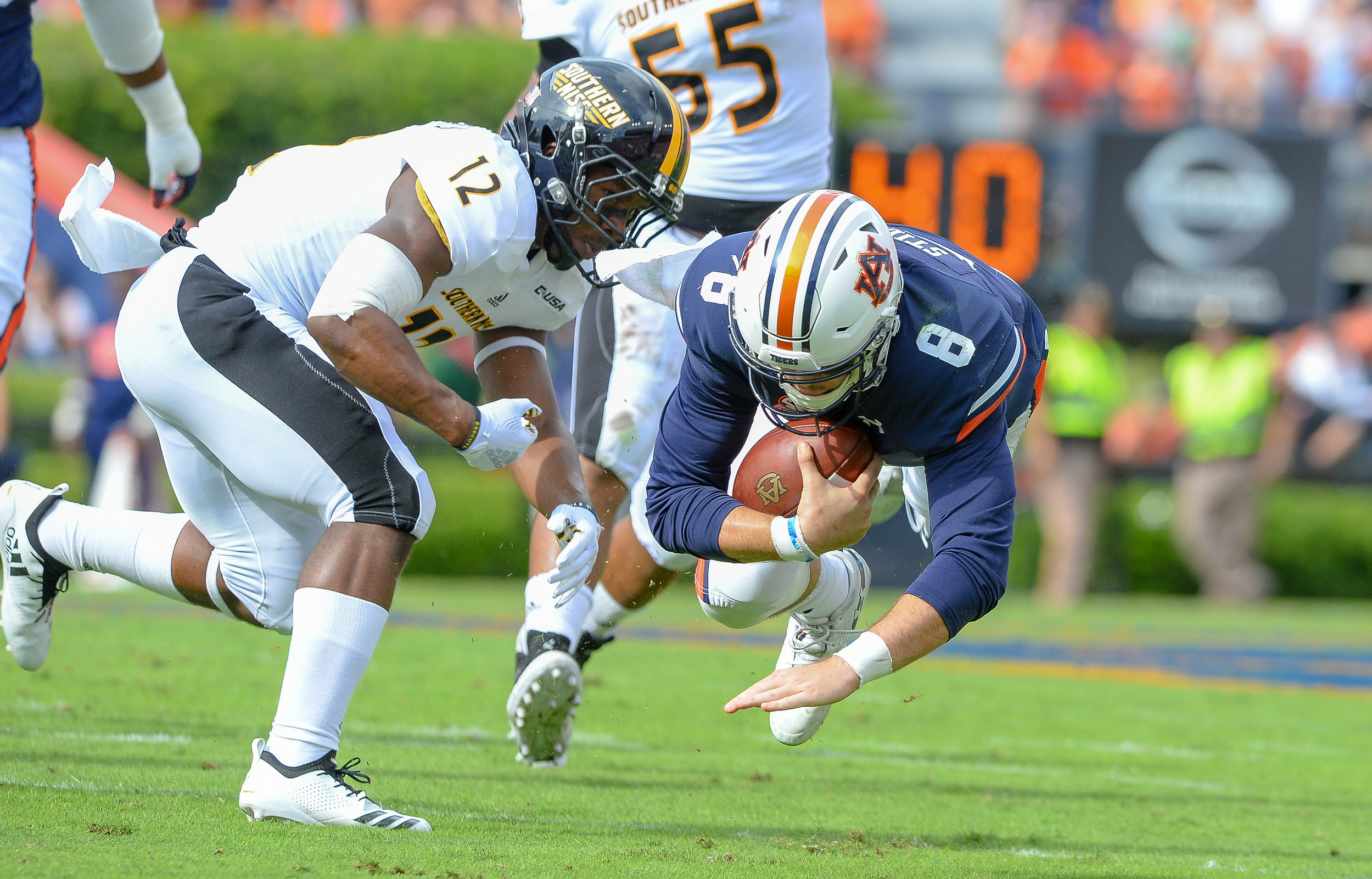 Auburn Tigers quarterback Jarrett Stidham (8) is brought down by Southern Miss Golden Eagles defensive back D.Q. Thomas (12) during the first half of Saturday's game, at Jordan Hare Stadium in Auburn AL. Daily Mountain Eagle -  Jeff Johnsey