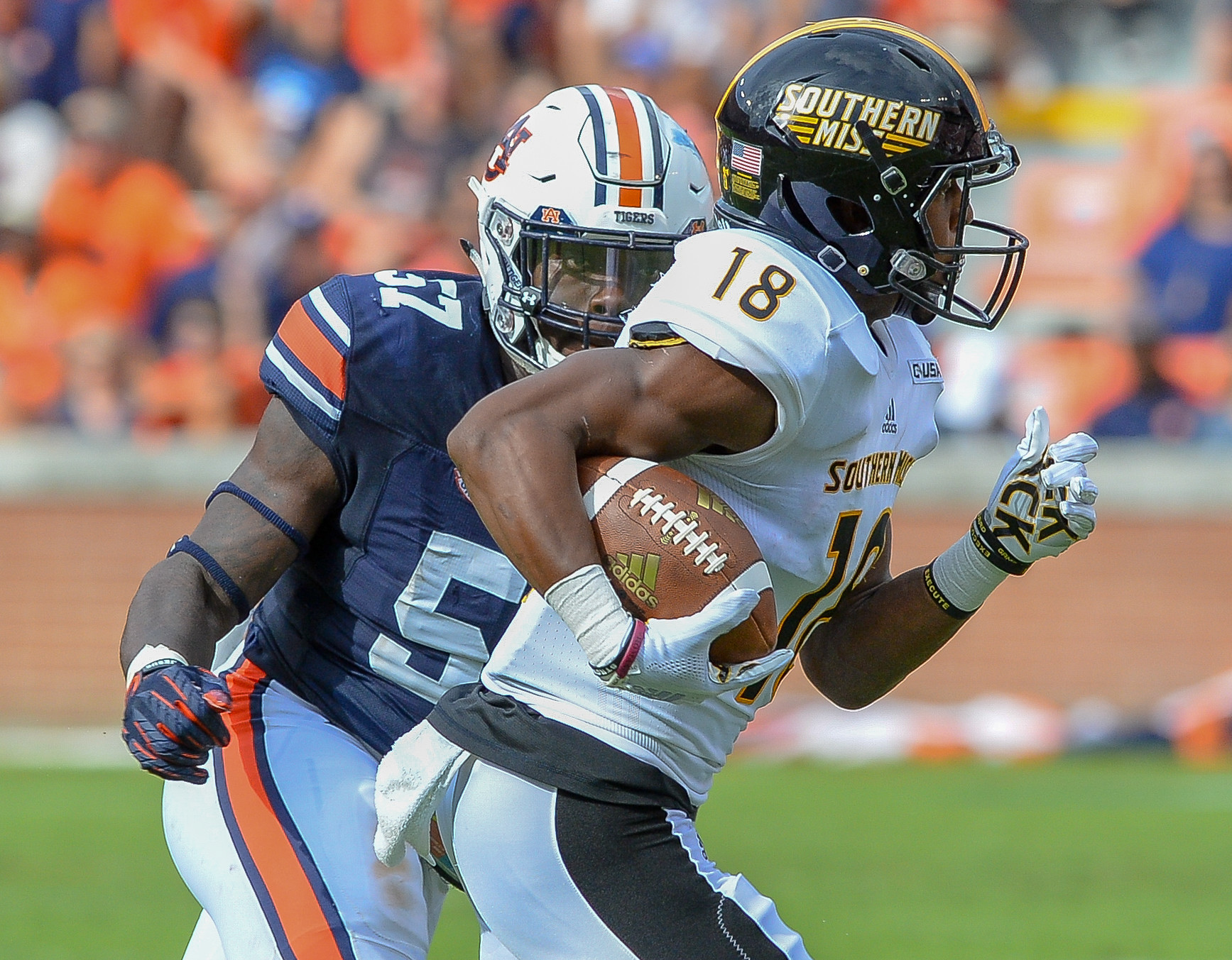 Auburn Tigers linebacker Deshaun Davis (57) closes in on Southern Miss Golden Eagles wide receiver De'Michael Harris (18) during the first half of Saturday's game, at Jordan Hare Stadium in Auburn AL. Daily Mountain Eagle -  Jeff Johnsey