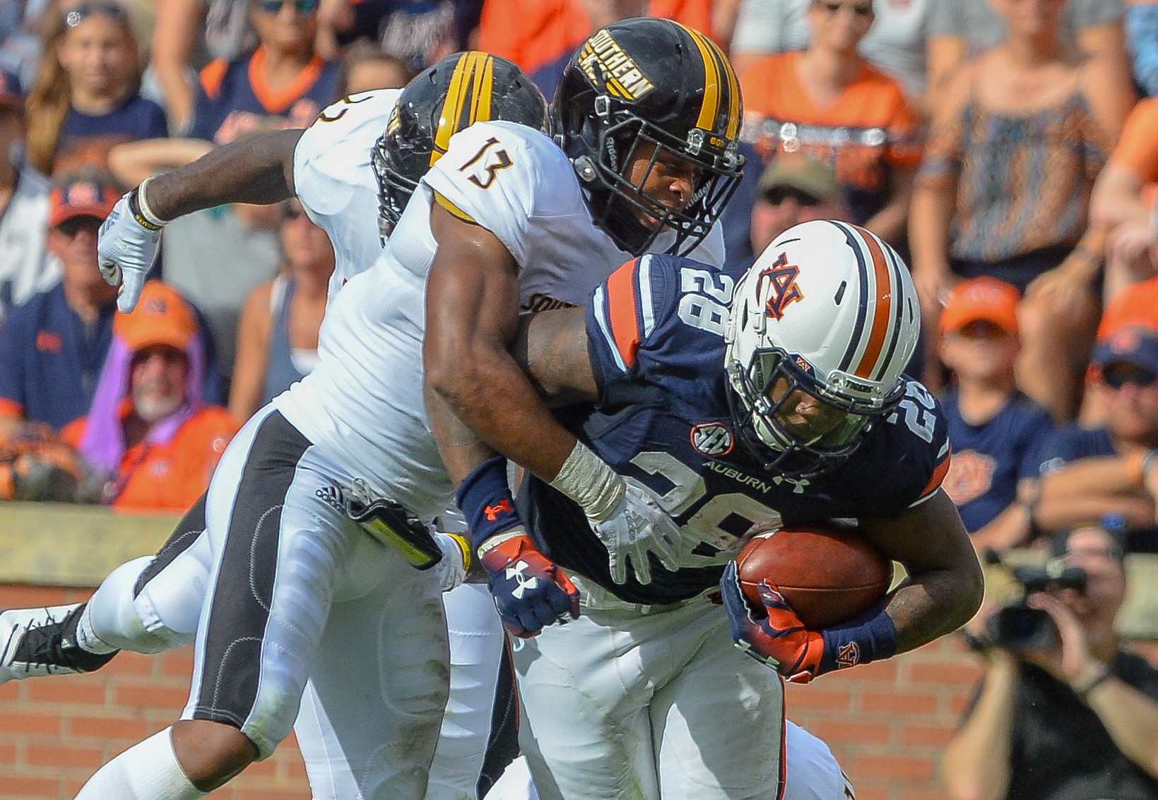 Southern Miss Golden Eagles defensive back Picasso Nelson Jr. (13) brings down Auburn Tigers running back JaTarvious Whitlow (28) during the first half of Saturday's game, at Jordan Hare Stadium in Auburn AL. Daily Mountain Eagle -  Jeff Johnsey