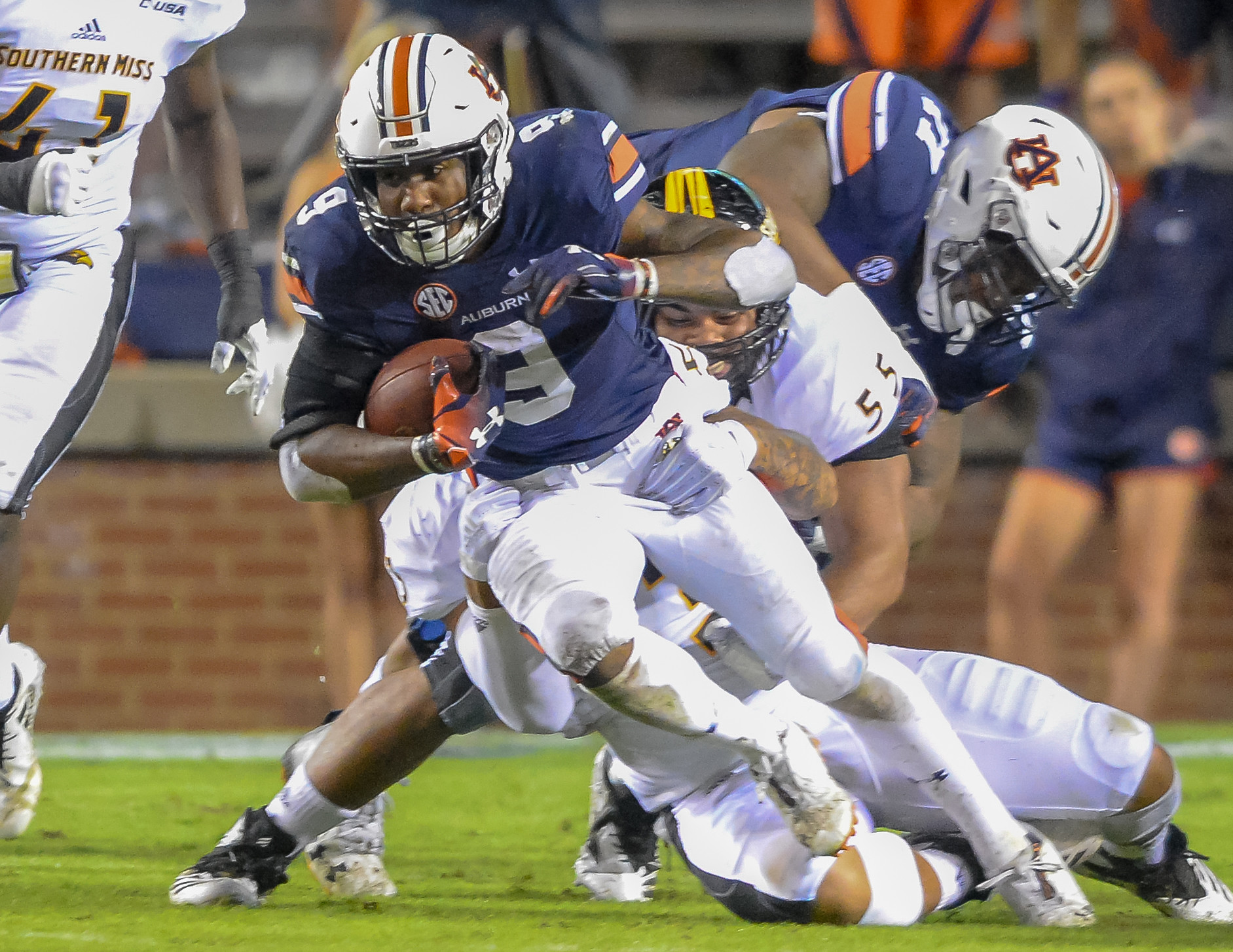 Auburn Tigers running back Kam Martin (9) is brought down during the first half of Saturday's game, at Jordan Hare Stadium in Auburn AL. Daily Mountain Eagle -  Jeff Johnsey