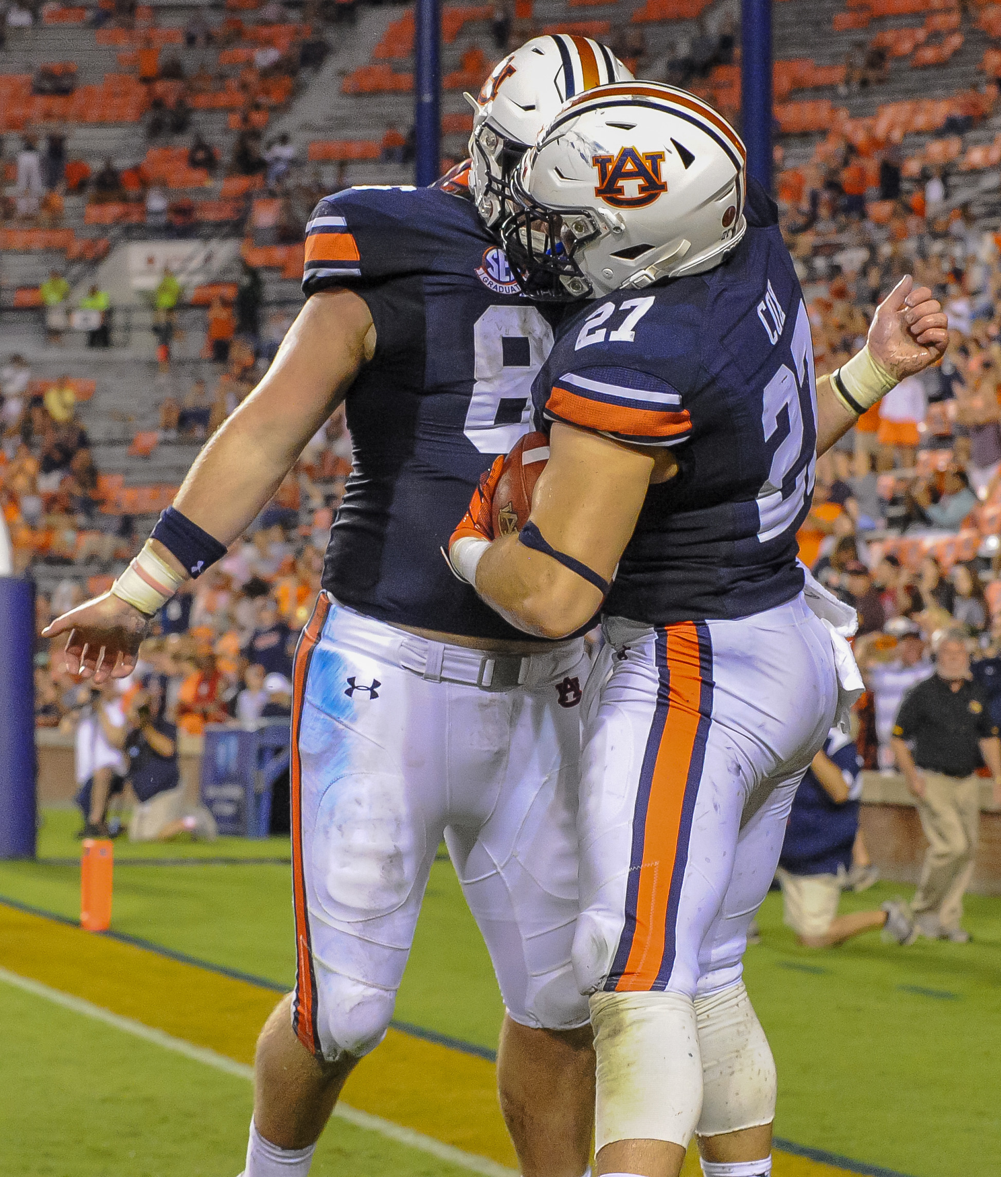 Auburn Tigers offensive lineman Tucker Brown (86) celebrates with fullback Chandler Cox  during the second half of Saturday's game, at Jordan Hare Stadium in Auburn AL. Daily Mountain Eagle -  Jeff Johnsey
