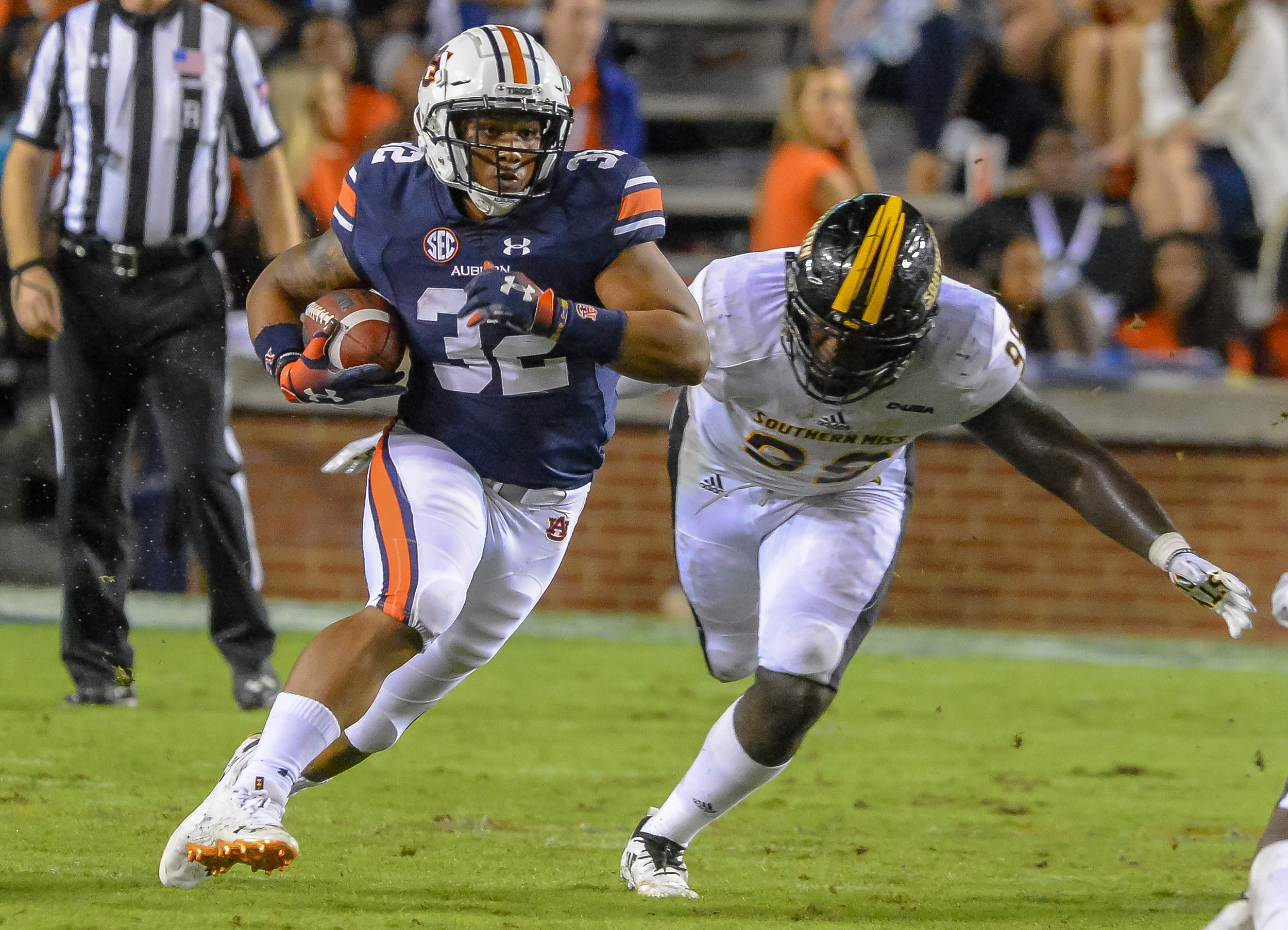 Auburn Tigers running back Malik Miller (32) runs after catching a pass during the second half of Saturday's game, at Jordan Hare Stadium in Auburn AL. Daily Mountain Eagle -  Jeff Johnsey