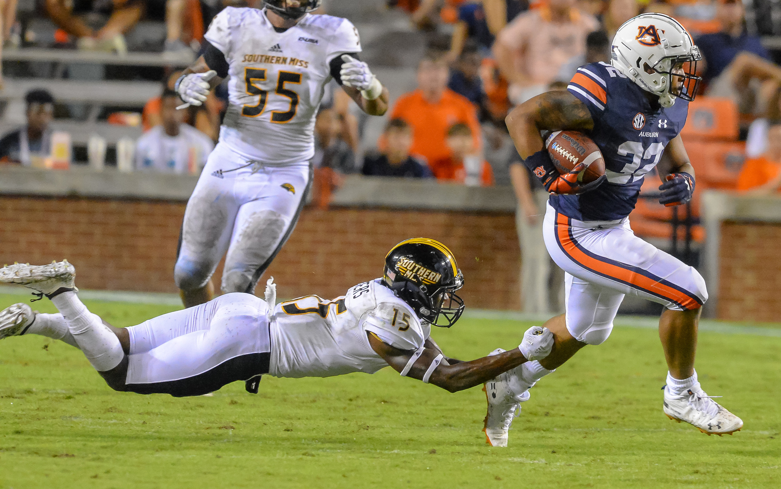 Southern Miss Golden Eagles defensive back Shannon Showers (15) dives at Auburn Tigers running back Malik Miller (32)  the second half of Saturday's game, at Jordan Hare Stadium in Auburn AL. Daily Mountain Eagle -  Jeff Johnsey