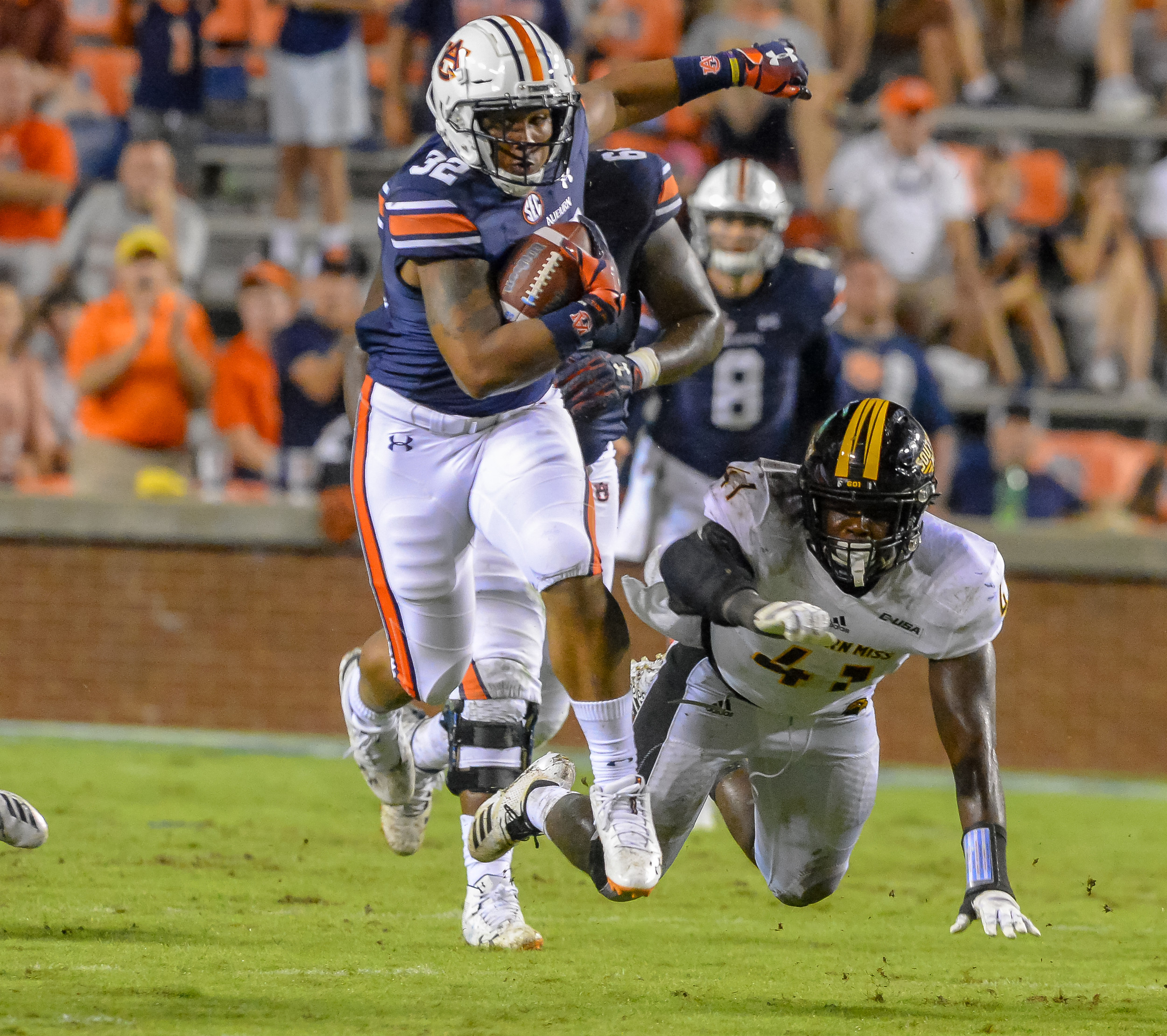 Auburn Tigers running back Malik Miller (32) breaks the tackle of Southern Miss Golden Eagles linebacker Santrell Latham (47) during the second half of Saturday's game, at Jordan Hare Stadium in Auburn AL. Daily Mountain Eagle -  Jeff Johnsey