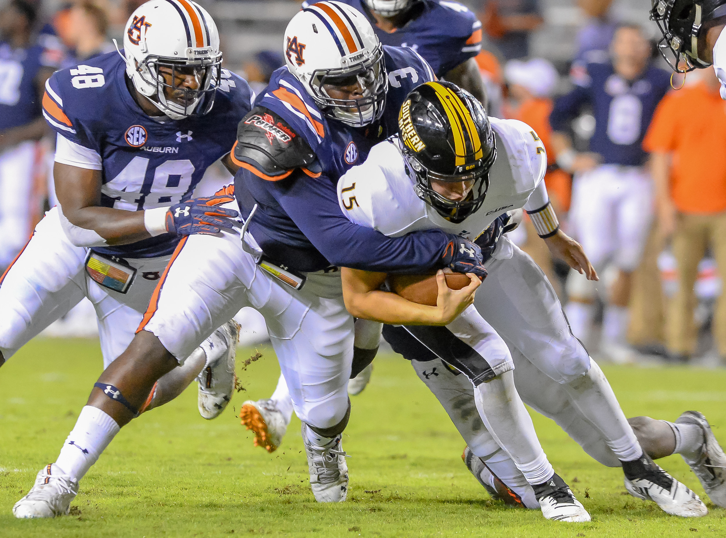 Auburn Tigers defensive lineman Marlon Davidson (3) brings down Southern Miss Golden Eagles quarterback Jack Abraham (15) during the second half of Saturday's game, at Jordan Hare Stadium in Auburn AL. Daily Mountain Eagle -  Jeff Johnsey