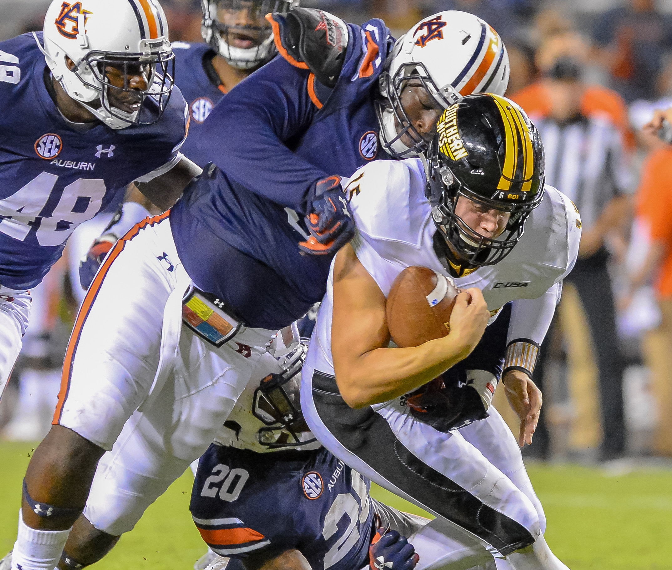 Auburn Tigers defensive lineman Marlon Davidson (3) tackles Southern Miss Golden Eagles quarterback Jack Abraham (15) during the second half of Saturday's game, at Jordan Hare Stadium in Auburn AL. Daily Mountain Eagle -  Jeff Johnsey