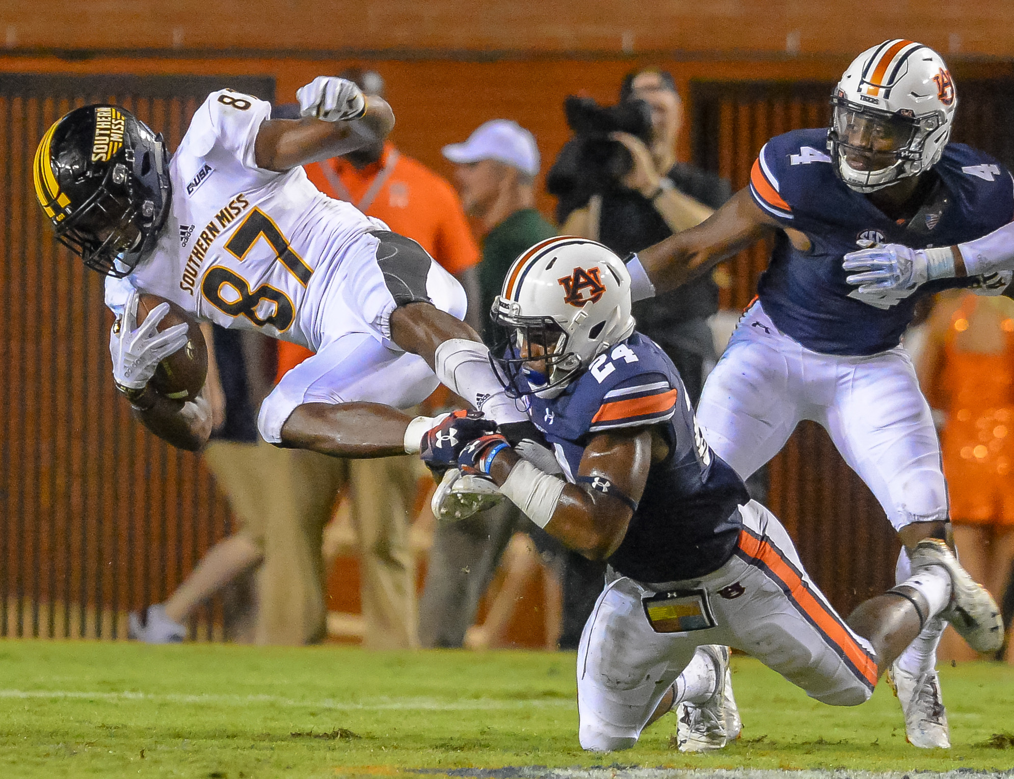 Southern Miss Golden Eagles wide receiver Tim Jones (87) is tackled by Auburn Tigers defensive back Daniel Thomas (24) during the second half of Saturday's game, at Jordan Hare Stadium in Auburn AL. Daily Mountain Eagle -  Jeff Johnsey