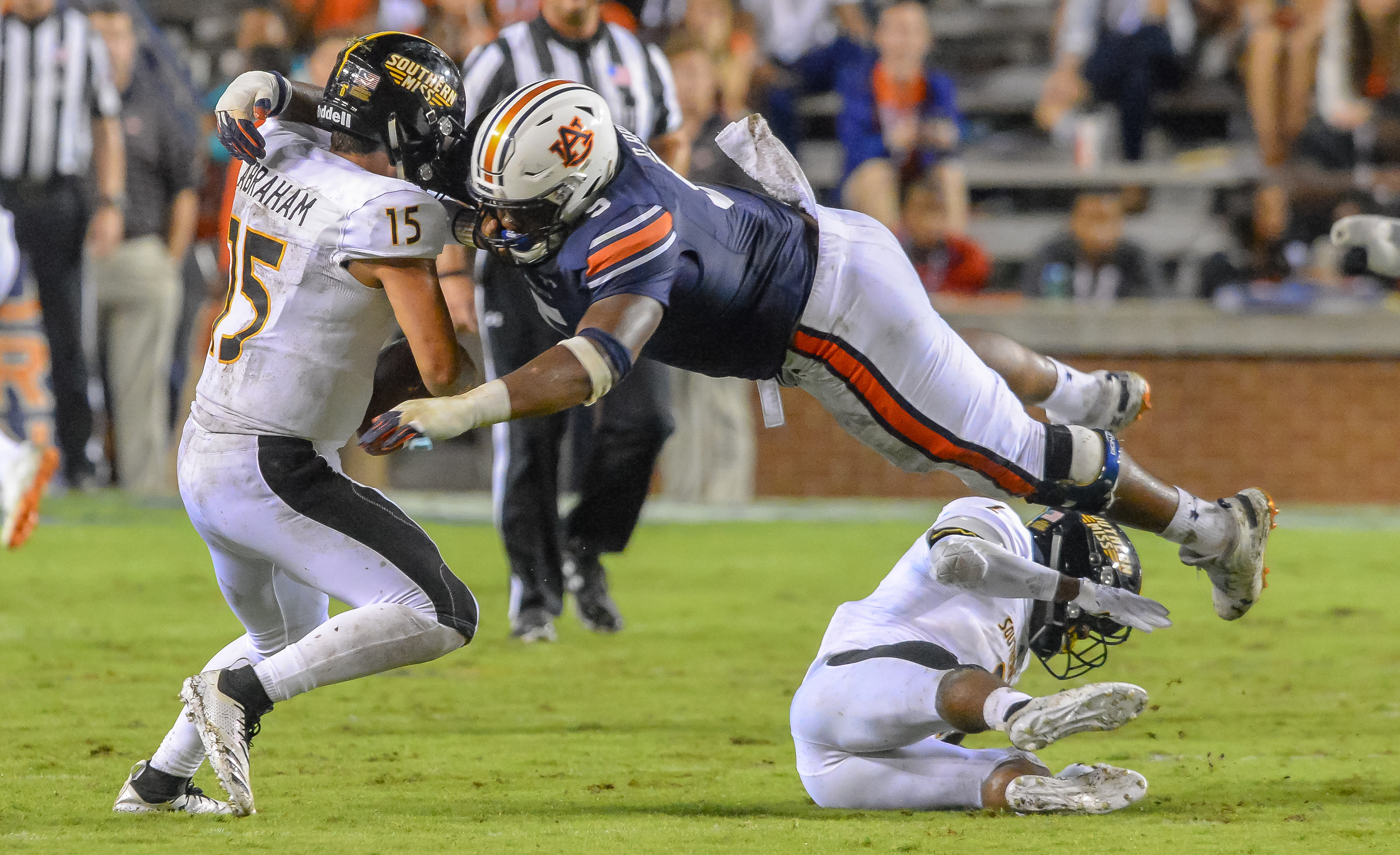 Southern Miss Golden Eagles quarterback Jack Abraham (15) is sacked by Auburn Tigers defensive lineman Derrick Brown (5) during the second half of Saturday's game, at Jordan Hare Stadium in Auburn AL. Daily Mountain Eagle -  Jeff Johnsey