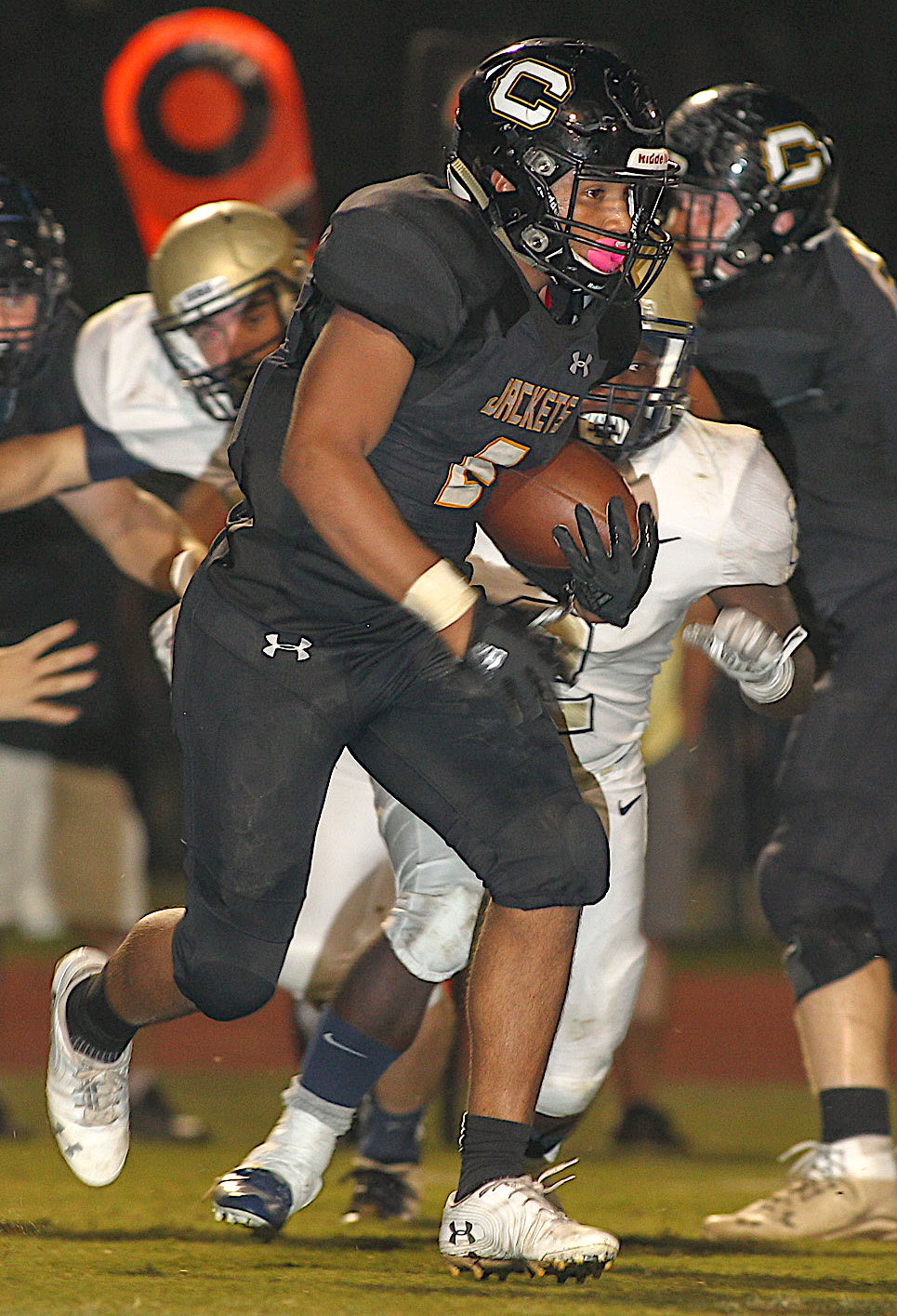 Corner's Nicholas Brashear (2) runs against Dora on Friday night. Brashear rushed for 117 yards and three touchdowns on 17 carries in  the Yellow Jackets' 30-7 win over Dora.