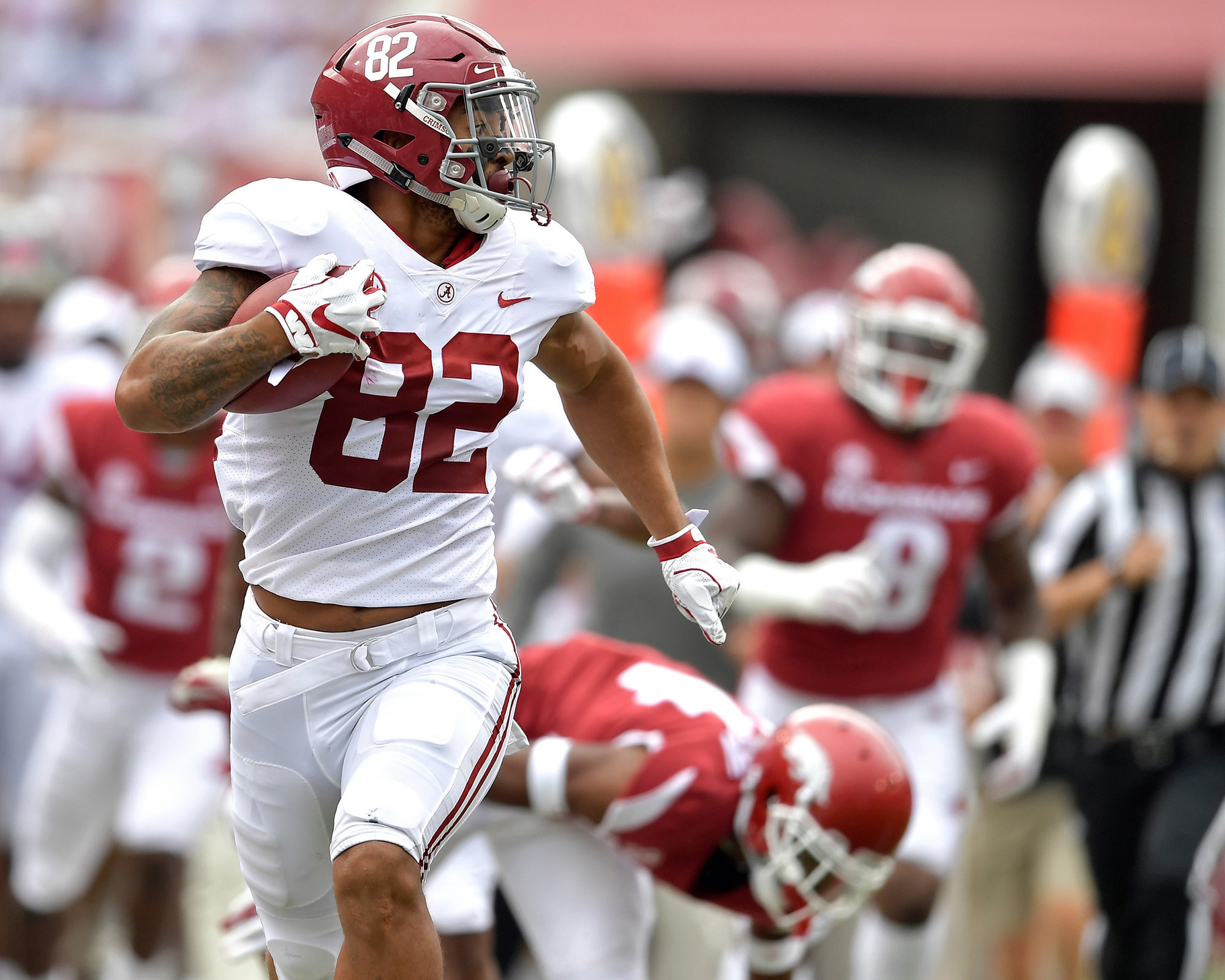 Alabama Crimson Tide tight end Irv Smith Jr. (82) on his way to a touchdown against the Arkansas Razorbacks on the first play of the game from scrimmage on Oct. 6, 2018, in Fayetteville, Ark. Alabama defeated Arkansas 65-31. (Photo by Lee Walls)