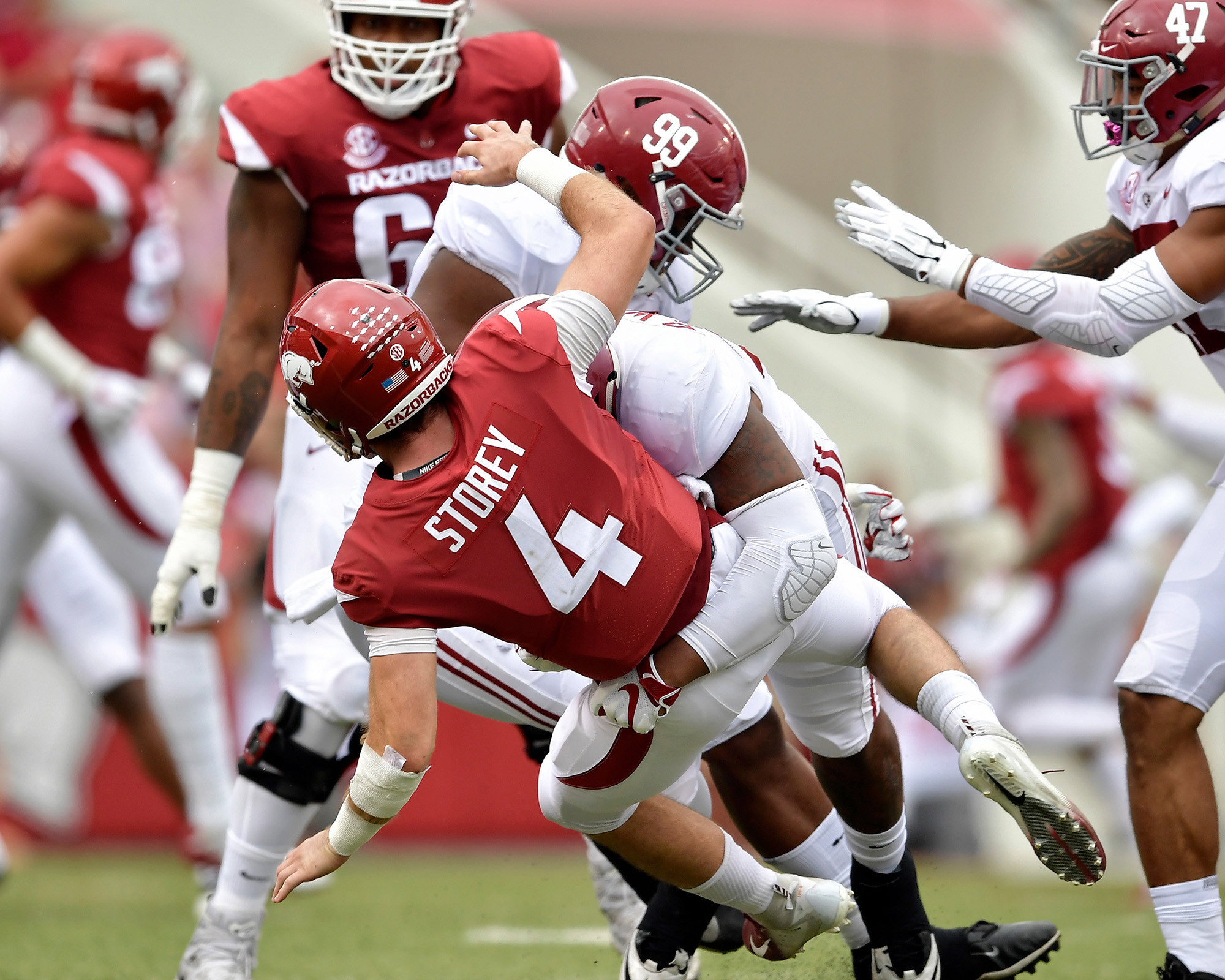 Arkansas Razorbacks quarterback Ty Storey (4) passes under pressure from Alabama Crimson Tide defensive linemen Raekwon Davis (99) and Quinnen Williams (92) in the first quarter of the NCAA football game at Razorback Stadium on Oct. 6, 2018, in Fayetteville, Ark. Alabama defeated Arkansas 65-31. (Photo by Lee Walls)