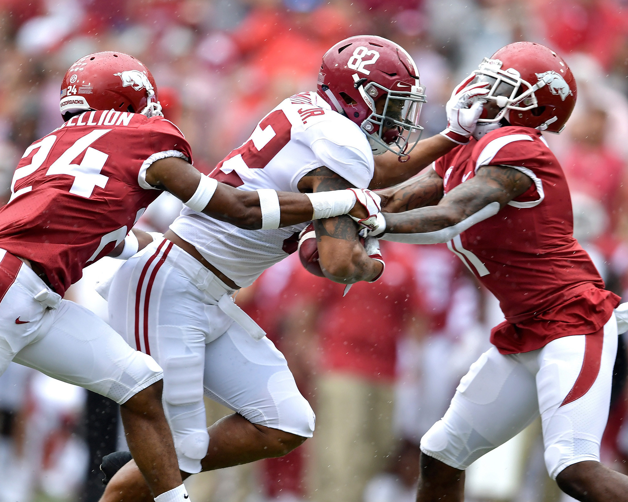 Alabama Crimson Tide tight end Irv Smith Jr. (82) adds yards after the catch in the first half of the NCAA football game against the Arkansas Razorbacks at Razorback Stadium on Oct. 6, 2018, in Fayetteville, Ark. Alabama defeated Arkansas 65-31. (Photo by Lee Walls)