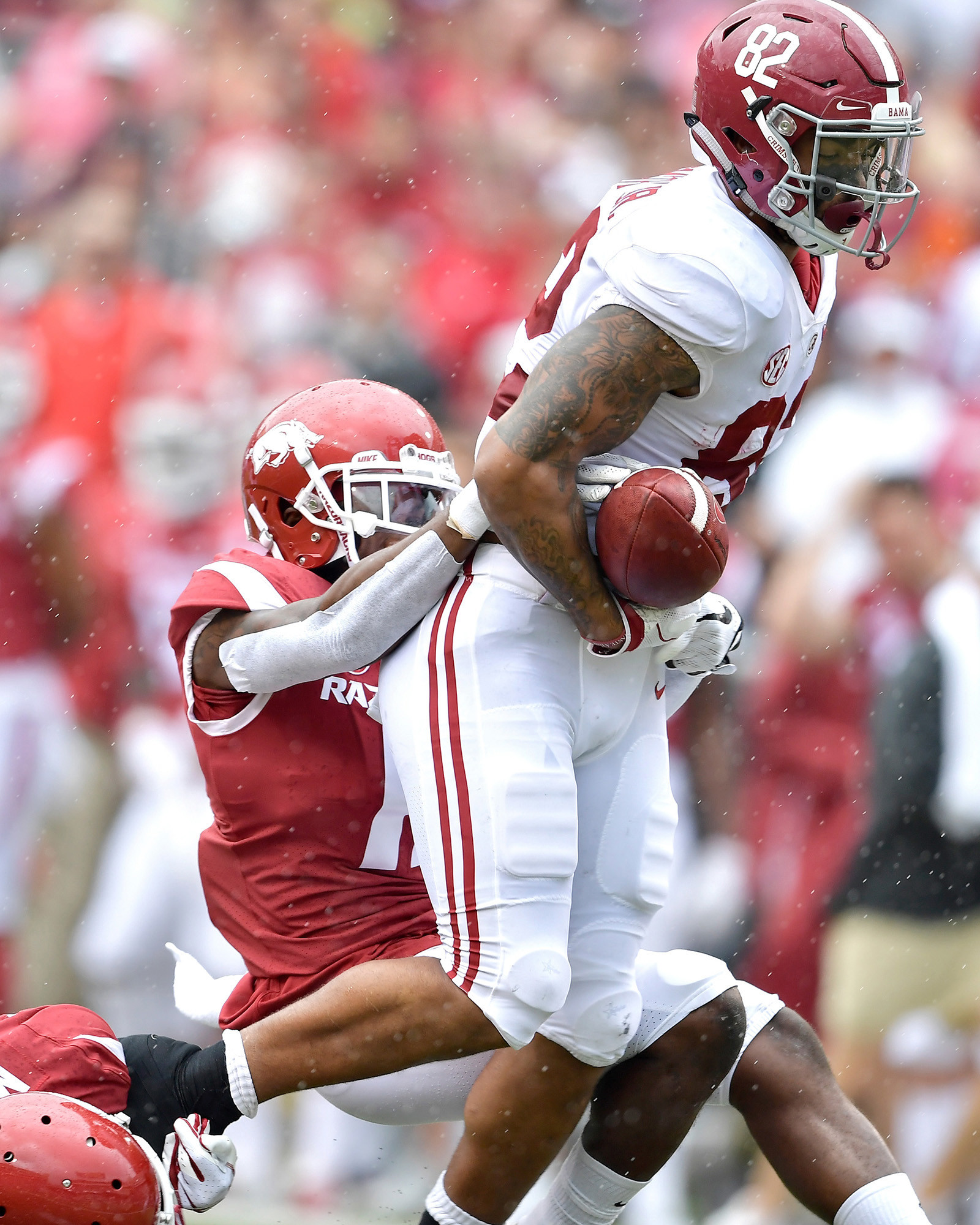 Alabama Crimson Tide tight end Irv Smith Jr. (82) fumbles the ball near the goal line after a long run in the first half of the NCAA football game against the Arkansas Razorbacks at Razorback Stadium on Oct. 6, 2018, in Fayetteville, Ark. Alabama defeated Arkansas 65-31. (Photo by Lee Walls)