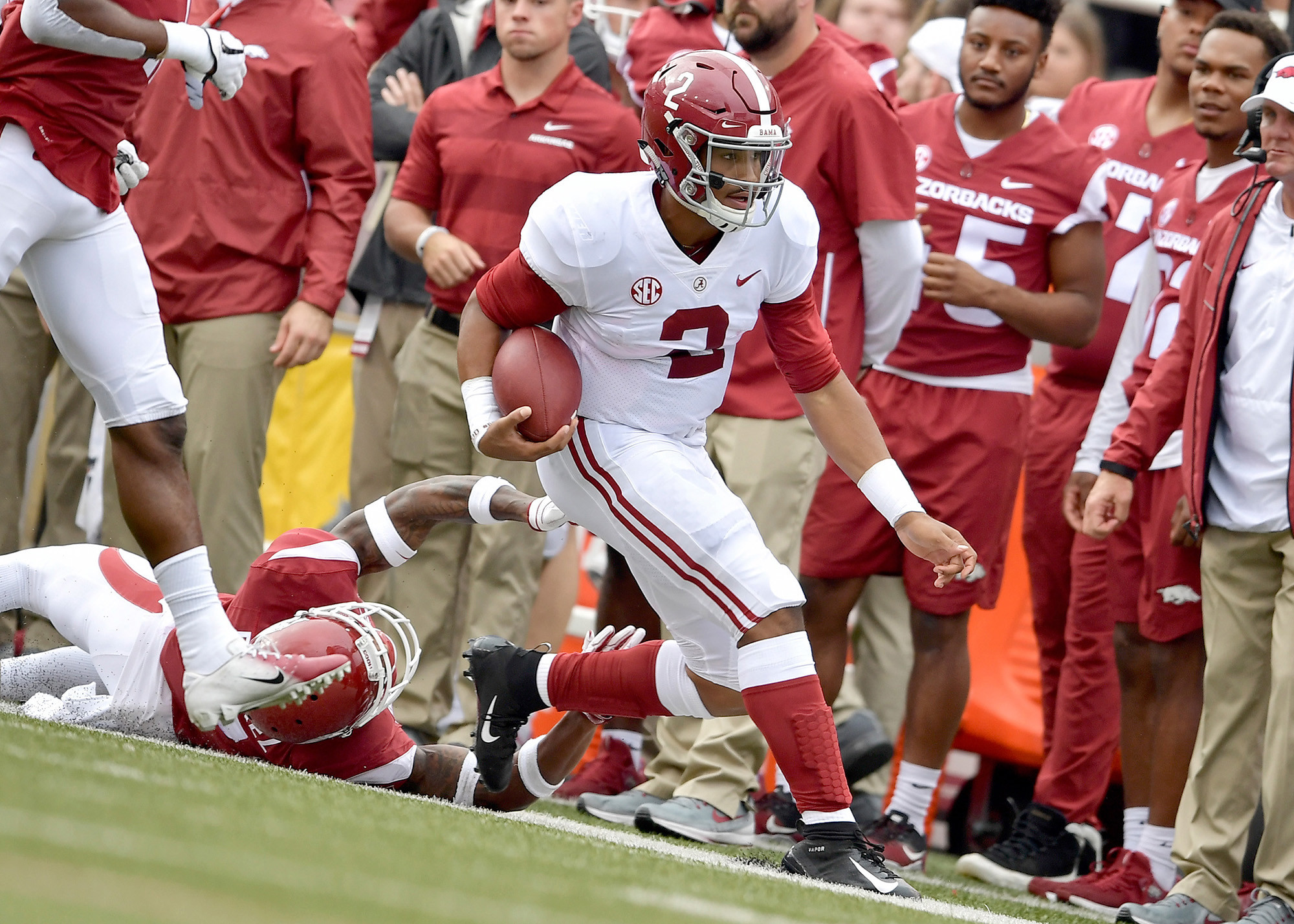 Alabama Crimson Tide quarterback Jalen Hurts (2) with a keeper in the first half of the NCAA football game against the Arkansas Razorbacks at Razorback Stadium on Oct. 6, 2018, in Fayetteville, Ark. Alabama defeated Arkansas 65-31. (Photo by Lee Walls)