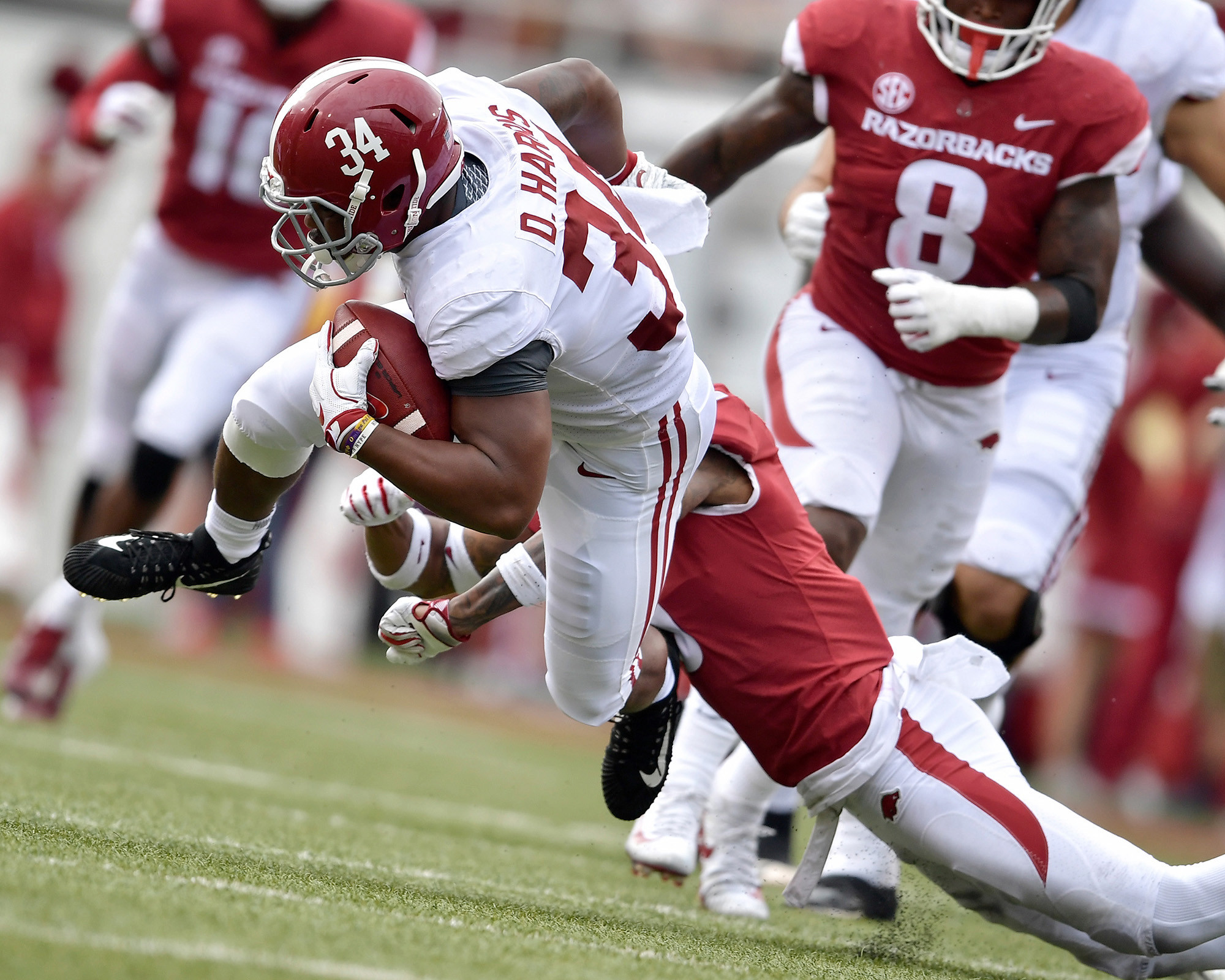 Alabama Crimson Tide running back Damien Harris (34) on a long carry in the first half of the NCAA football game against the Arkansas Razorbacks at Razorback Stadium on Oct. 6, 2018, in Fayetteville, Ark. Alabama defeated Arkansas 65-31. (Photo by Lee Walls)