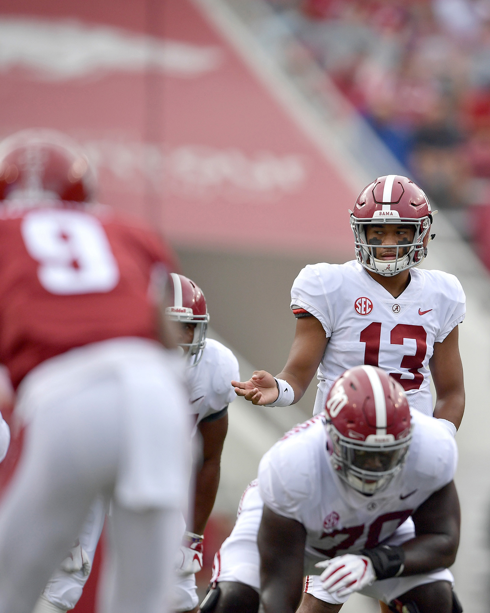 Alabama Crimson Tide quarterback Tua Tagovailoa (13) calling a play during the first half of the NCAA football game against the Arkansas Razorbacks at Razorback Stadium on Oct. 6, 2018, in Fayetteville, Ark. Alabama defeated Arkansas 65-31. (Photo by Lee Walls)
