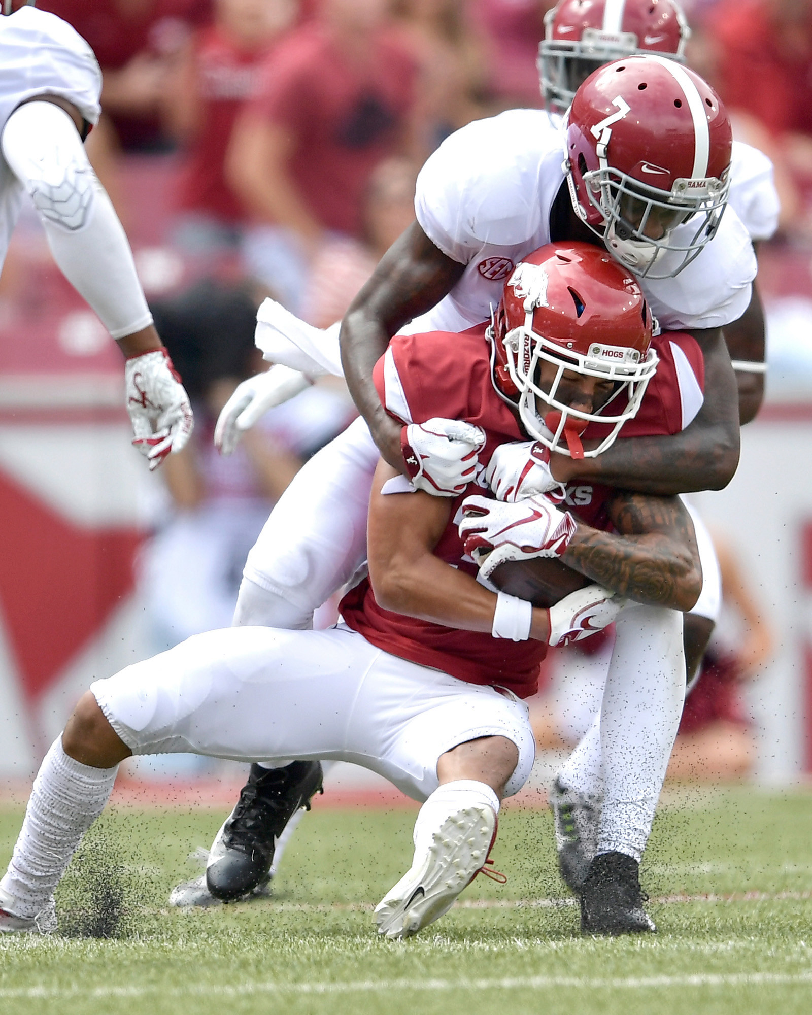 Alabama Crimson Tide defensive back Trevon Diggs (7) with a tackle during the first half of the NCAA football game against the Arkansas Razorbacks at Razorback Stadium on Oct. 6, 2018, in Fayetteville, Ark. Alabama defeated Arkansas 65-31. (Photo by Lee Walls)