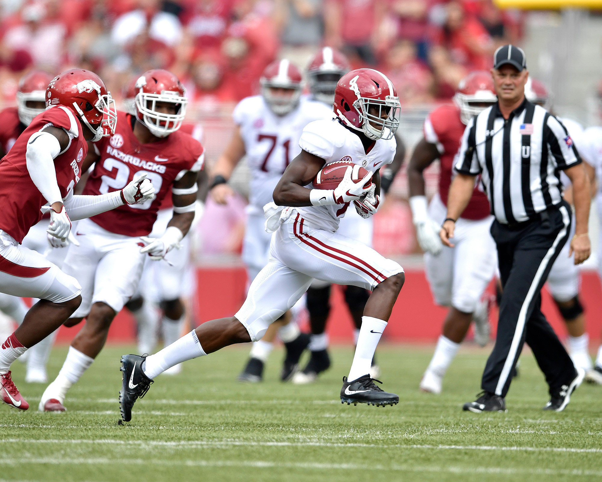 Alabama Crimson Tide wide receiver Jerry Jeudy (4) with a catch on a crossing route in the first half of the NCAA football game against the Arkansas Razorbacks at Razorback Stadium on Oct. 6, 2018, in Fayetteville, Ark. Alabama defeated Arkansas 65-31. (Photo by Lee Walls)