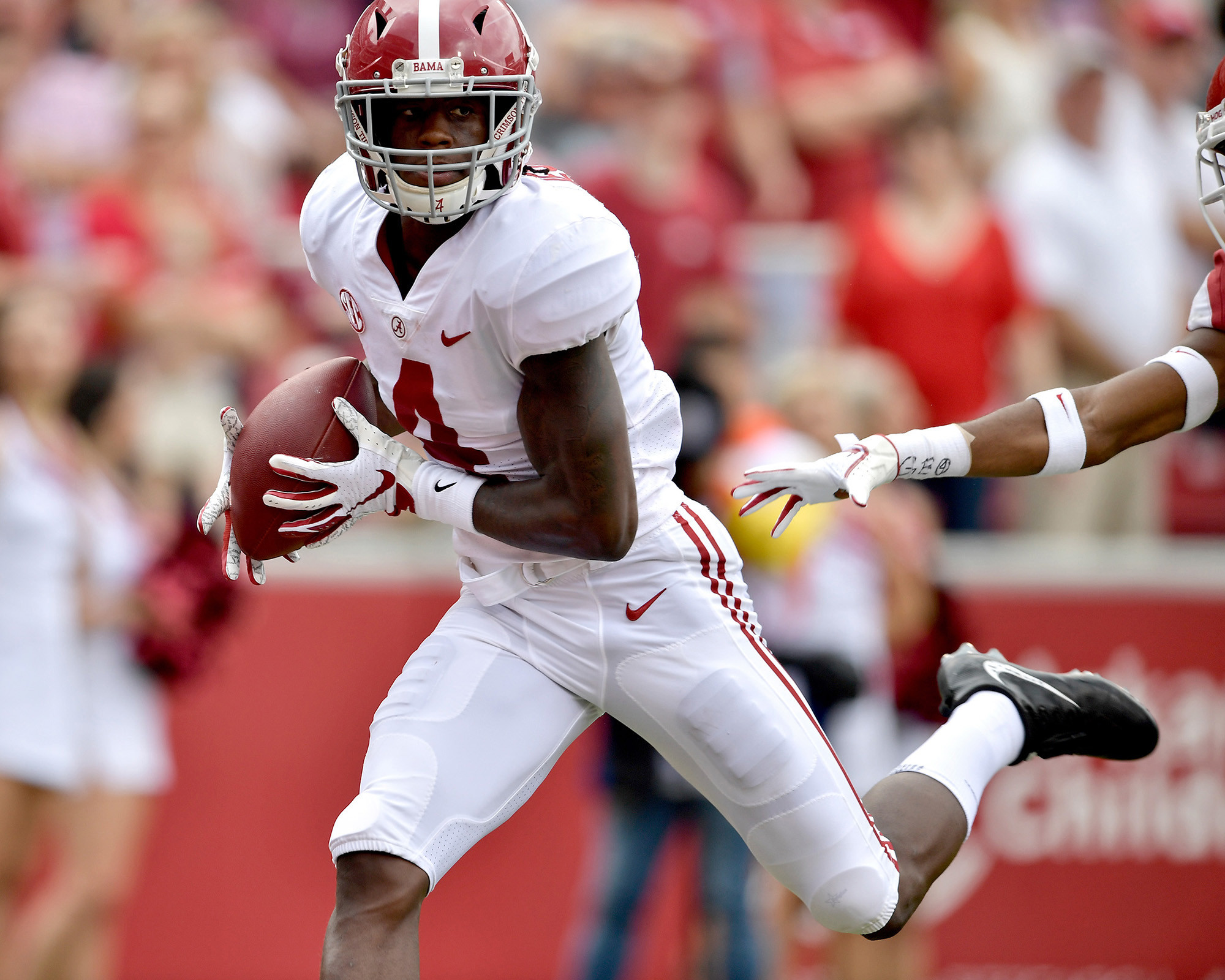 Alabama Crimson Tide wide receiver Jerry Jeudy (4) with a catch and a touchdown in the first half of the NCAA football game against the Arkansas Razorbacks at Razorback Stadium on Oct. 6, 2018, in Fayetteville, Ark. Alabama defeated Arkansas 65-31. (Photo by Lee Walls)