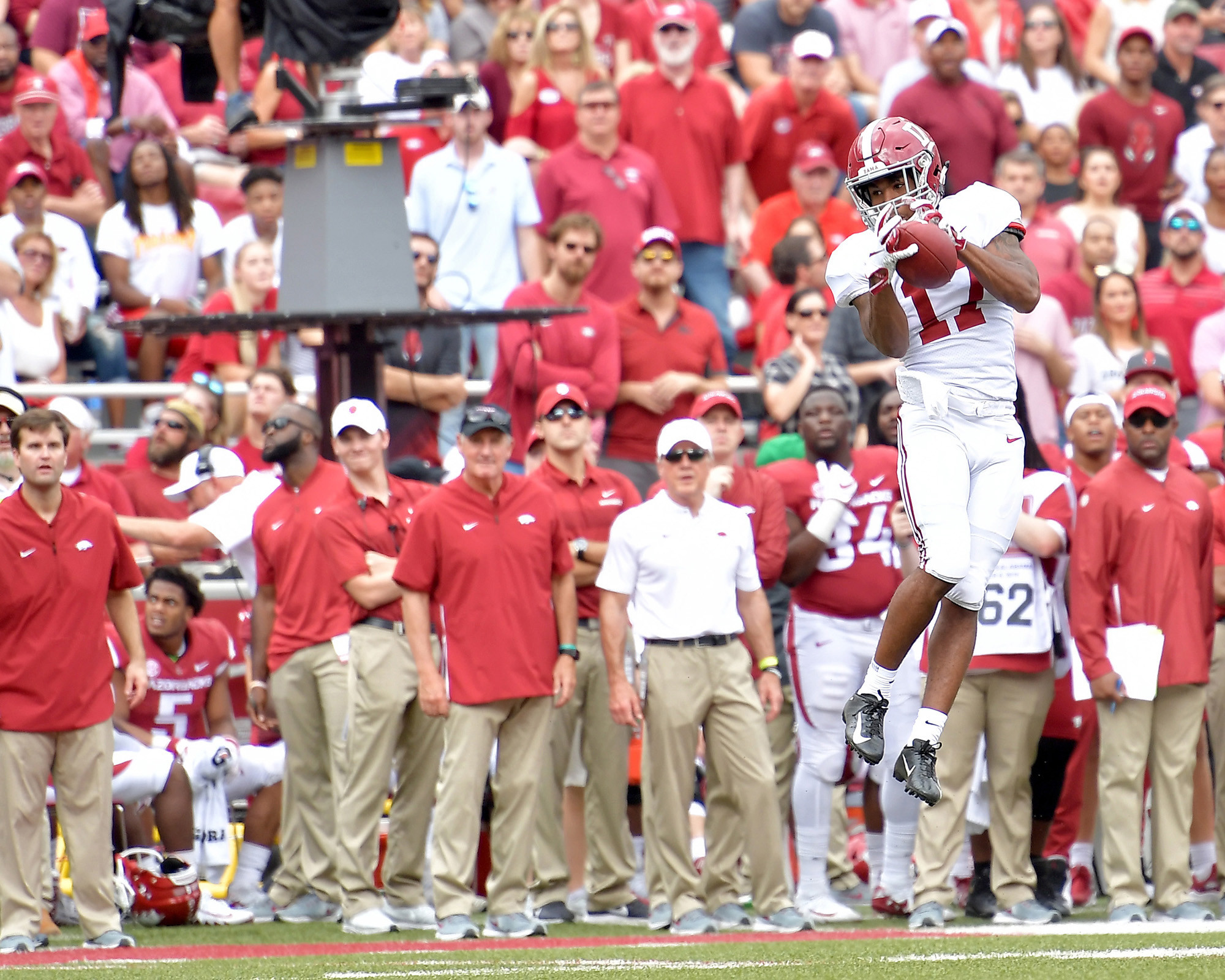 Alabama Crimson Tide wide receiver Jaylen Waddle (17) with the mid-air catch in the first half of the NCAA football game at Razorback Stadium on Oct. 6, 2018, in Fayetteville, Ark. Alabama defeated Arkansas 65-31. (Photo by Lee Walls)