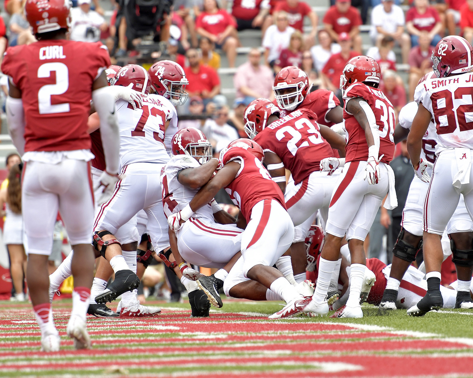 Alabama Crimson Tide running back Damien Harris (34) scores a touchdown in the first half of the NCAA football game at Razorback Stadium on Oct. 6, 2018, in Fayetteville, Ark. Alabama defeated Arkansas 65-31. (Photo by Lee Walls)