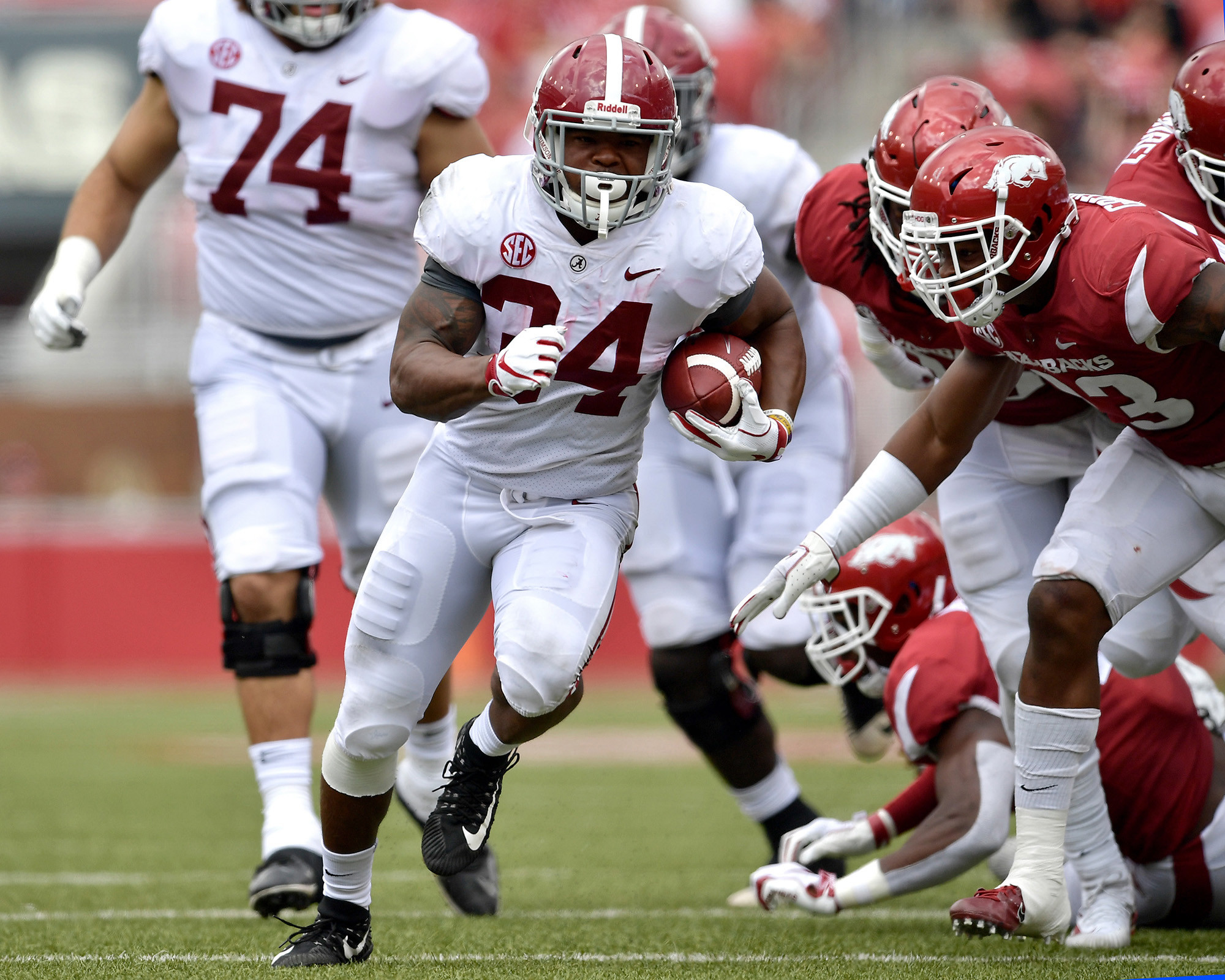 Alabama Crimson Tide running back Damien Harris (34) finds some running room in the second half of the NCAA football game against the Arkansas Razorbacks at Razorback Stadium on Oct. 6, 2018, in Fayetteville, Ark. Alabama defeated Arkansas 65-31. (Photo by Lee Walls)