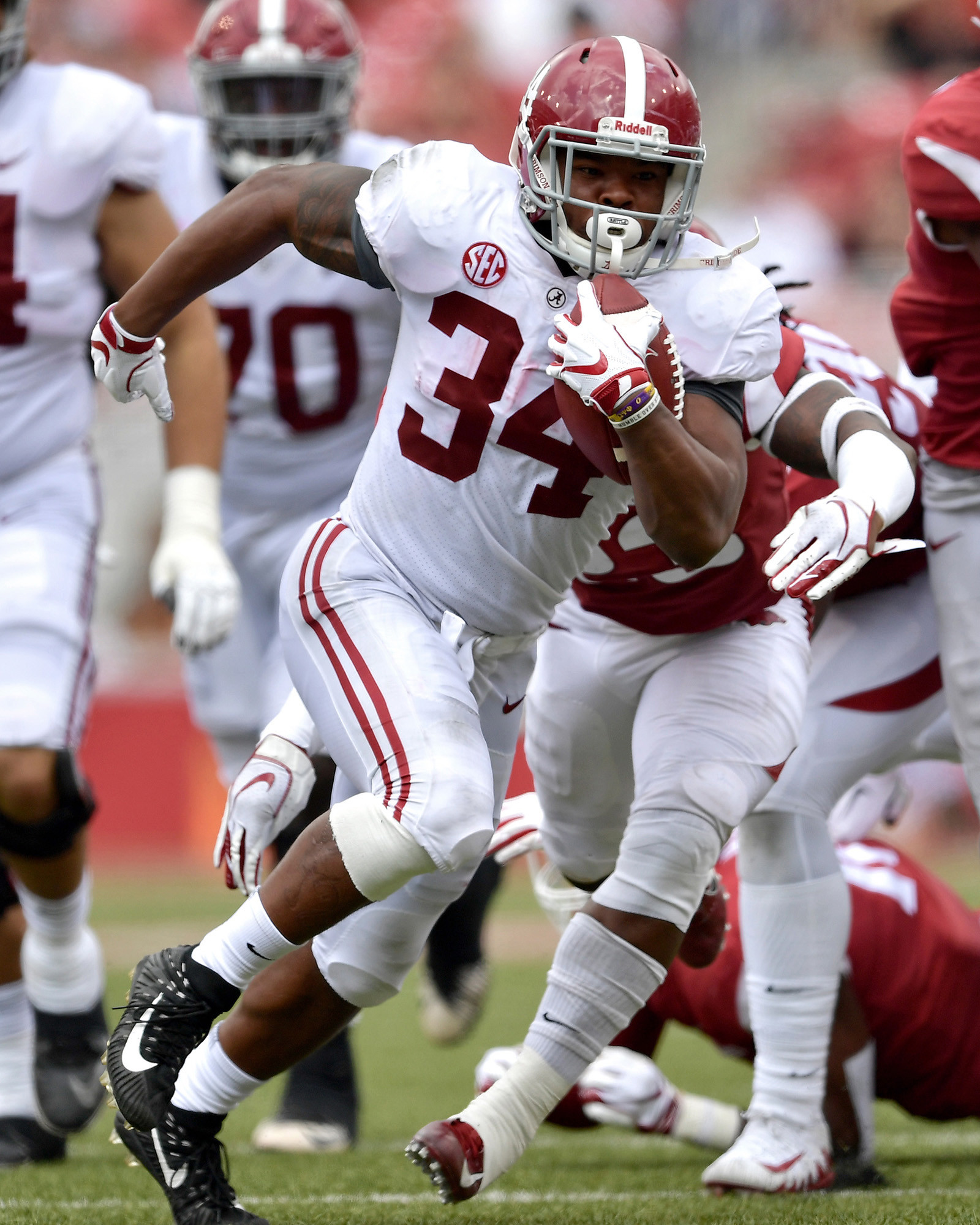 Alabama Crimson Tide running back Damien Harris (34) finds some running room in the second half of the NCAA football game against the Arkansas Razorbacks at Razorback Stadium on Oct. 6, 2018, in Fayetteville, Ark. Alabama defeated Arkansas 65-31. (Photo by Lee Walls) . Alabama defeated Arkansas 65-31. (Photo by Lee Walls)